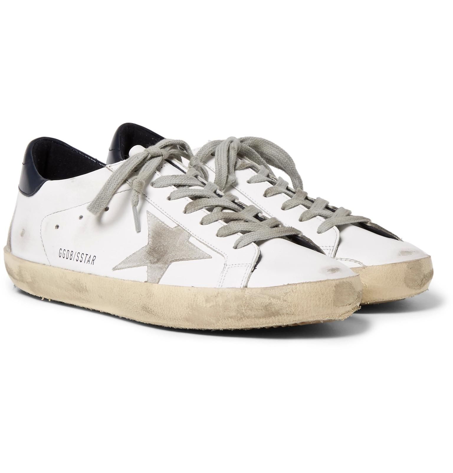 64792b1067a70 Golden Goose Deluxe Brand. Men s White Superstar Distressed Leather And Suede  Sneakers
