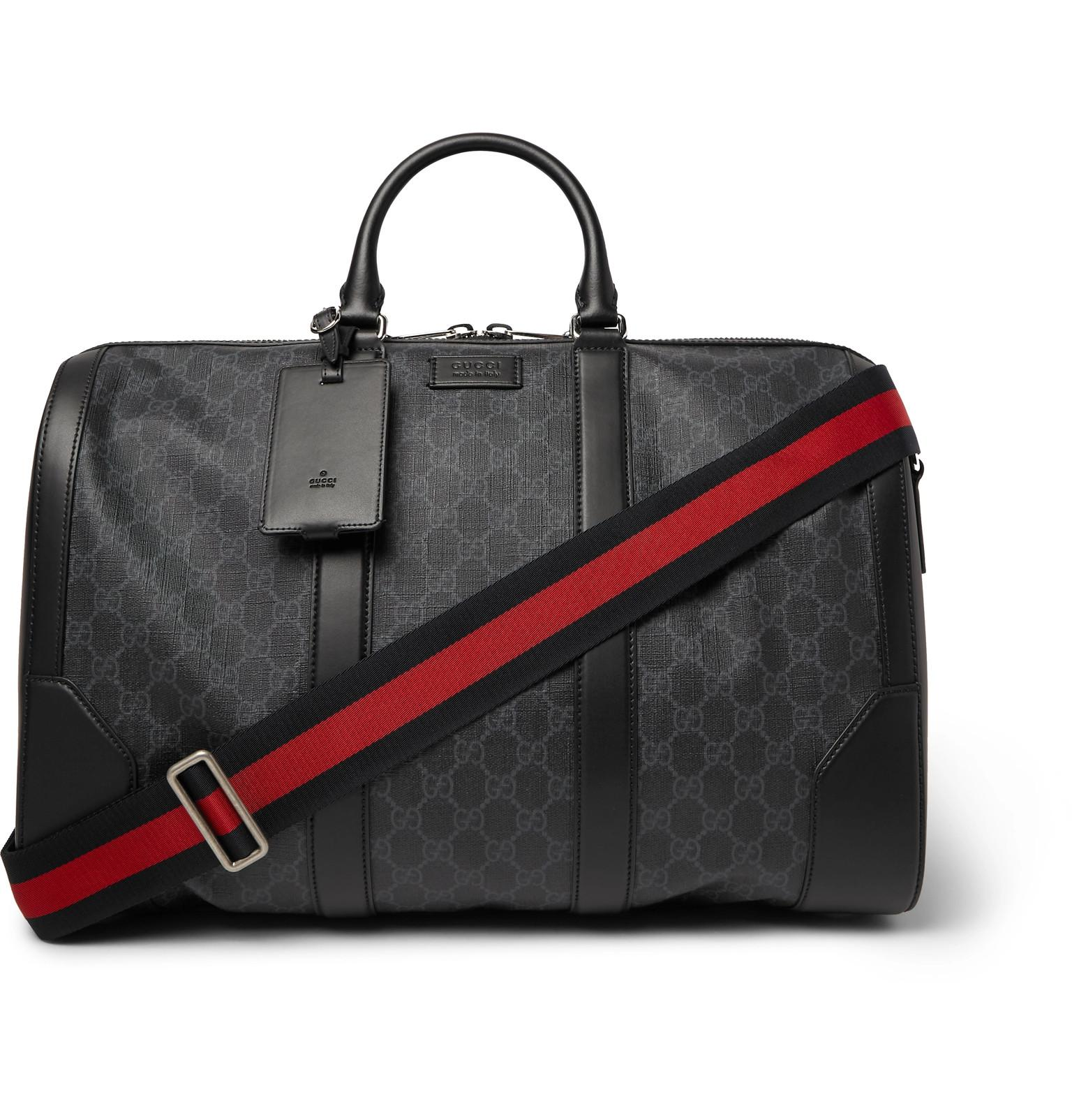 5a4e21ecfcdd Gucci Leather-trimmed Monogrammed Coated-canvas Holdall in Black for ...