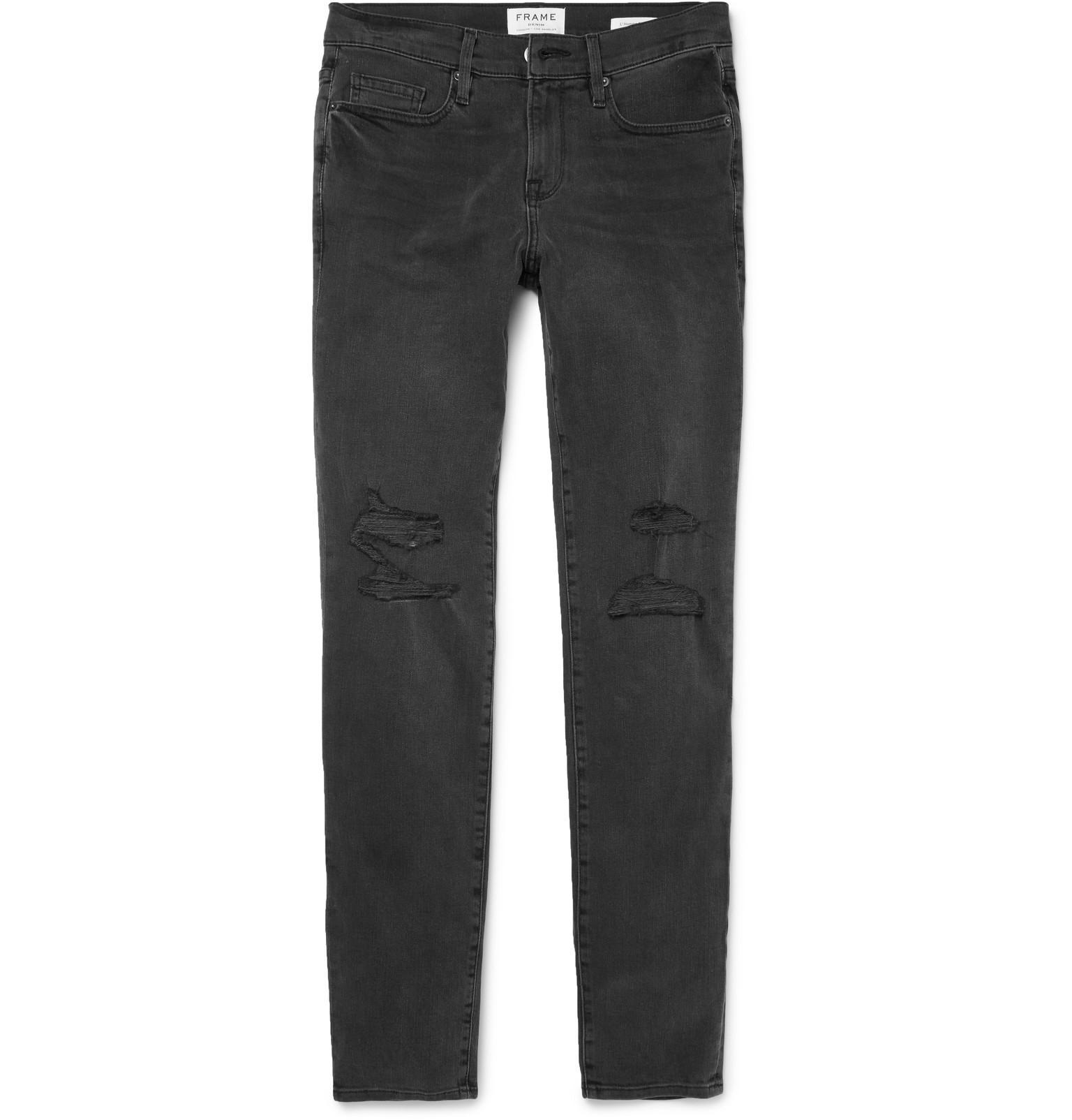 frame l 39 homme slim fit distressed stretch denim jeans in black for men lyst. Black Bedroom Furniture Sets. Home Design Ideas