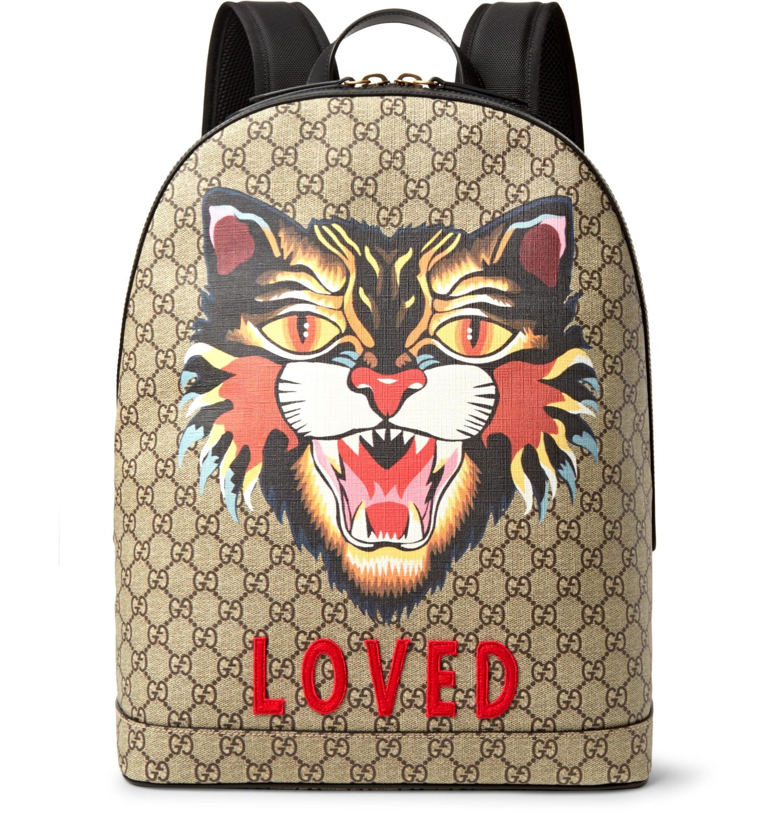 5543207a2bd2 Gucci Angry Cat Leather-trimmed Appliquéd Monogrammed Coated-canvas ...