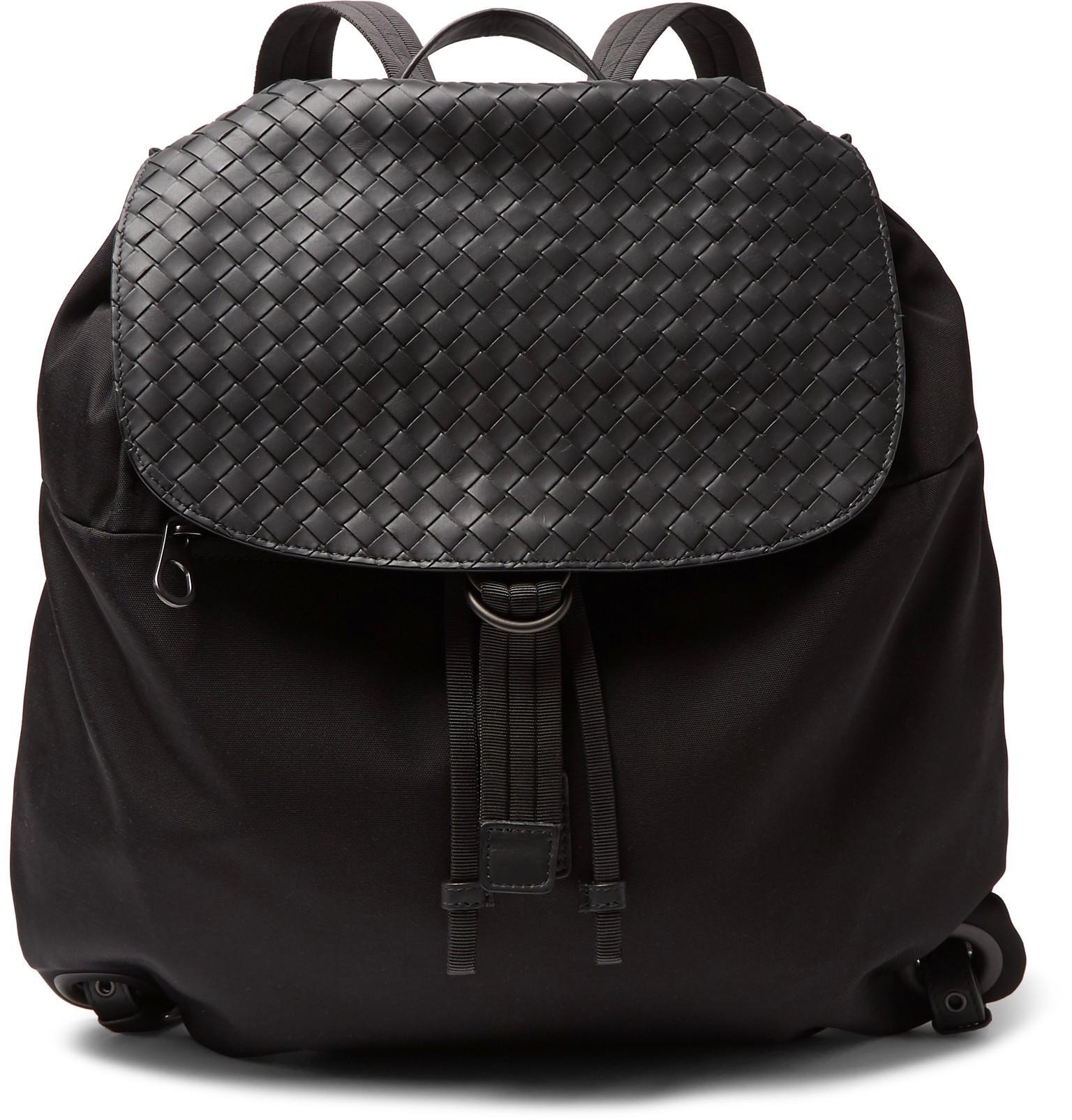 acc098d514 Lyst - Bottega Veneta Intrecciato Leather-panelled Canvas Backpack ...