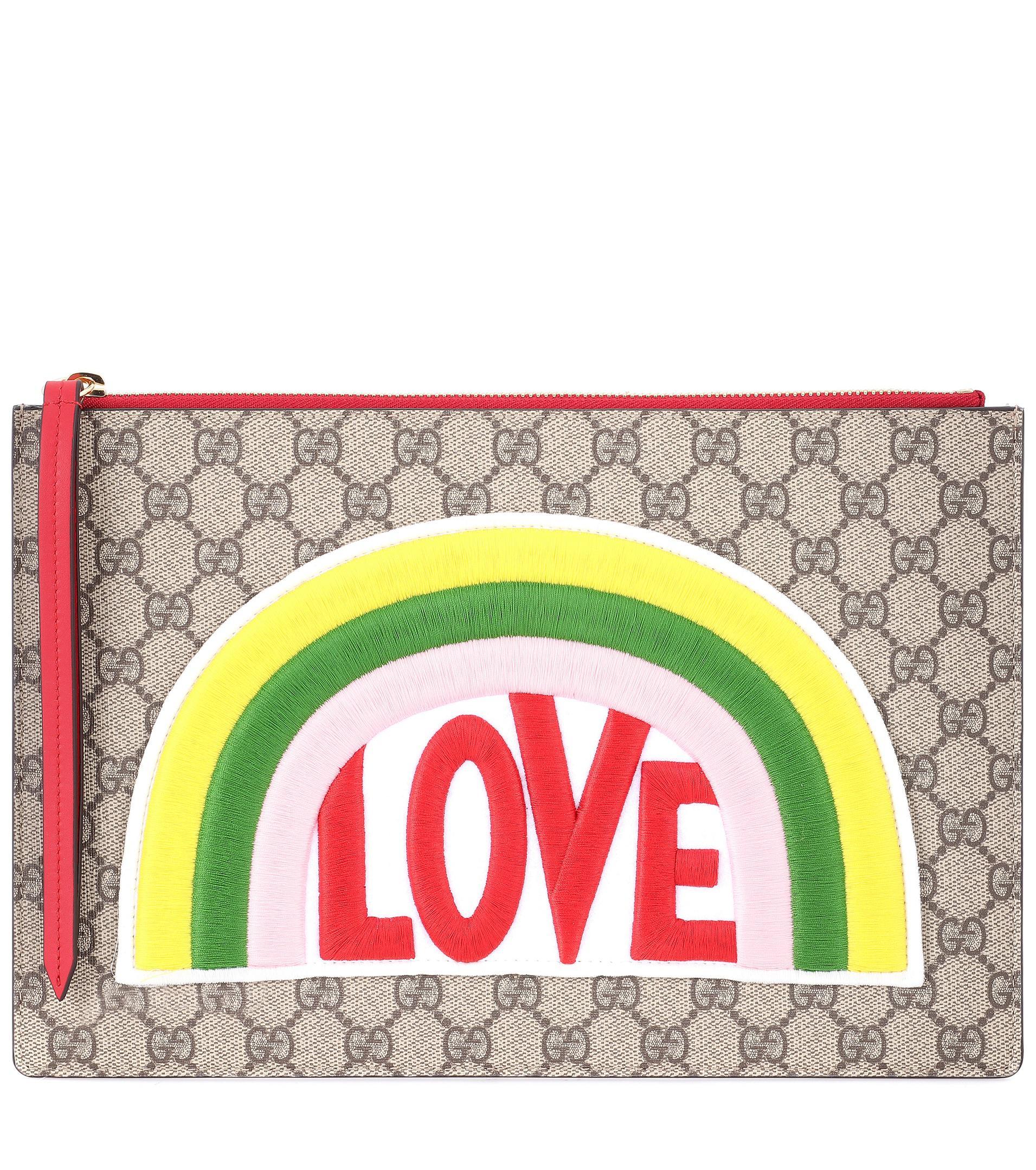 a8a72b64852d Lyst - Pochette en cuir et toile GG Suprême à appliqué Gucci