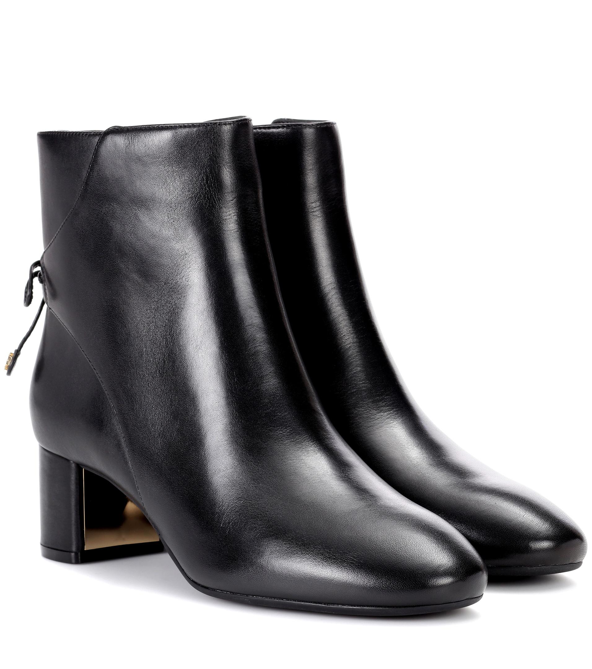 1094d086e722 Gallery. Previously sold at  Mytheresa · Women s Black Zip Boots ...