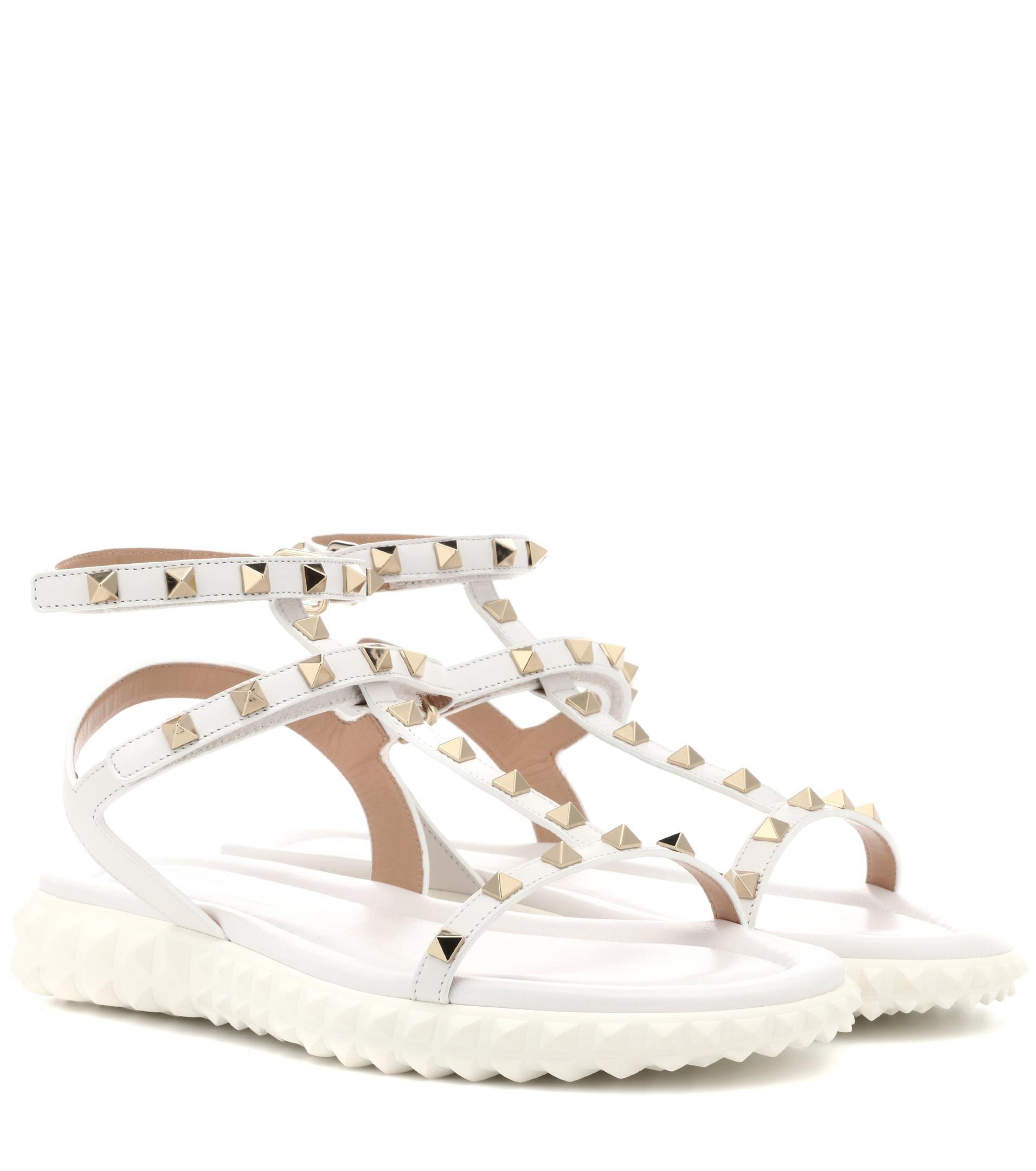 f993bd1a8e2e Valentino Free Rockstud Leather Sandals in White - Lyst
