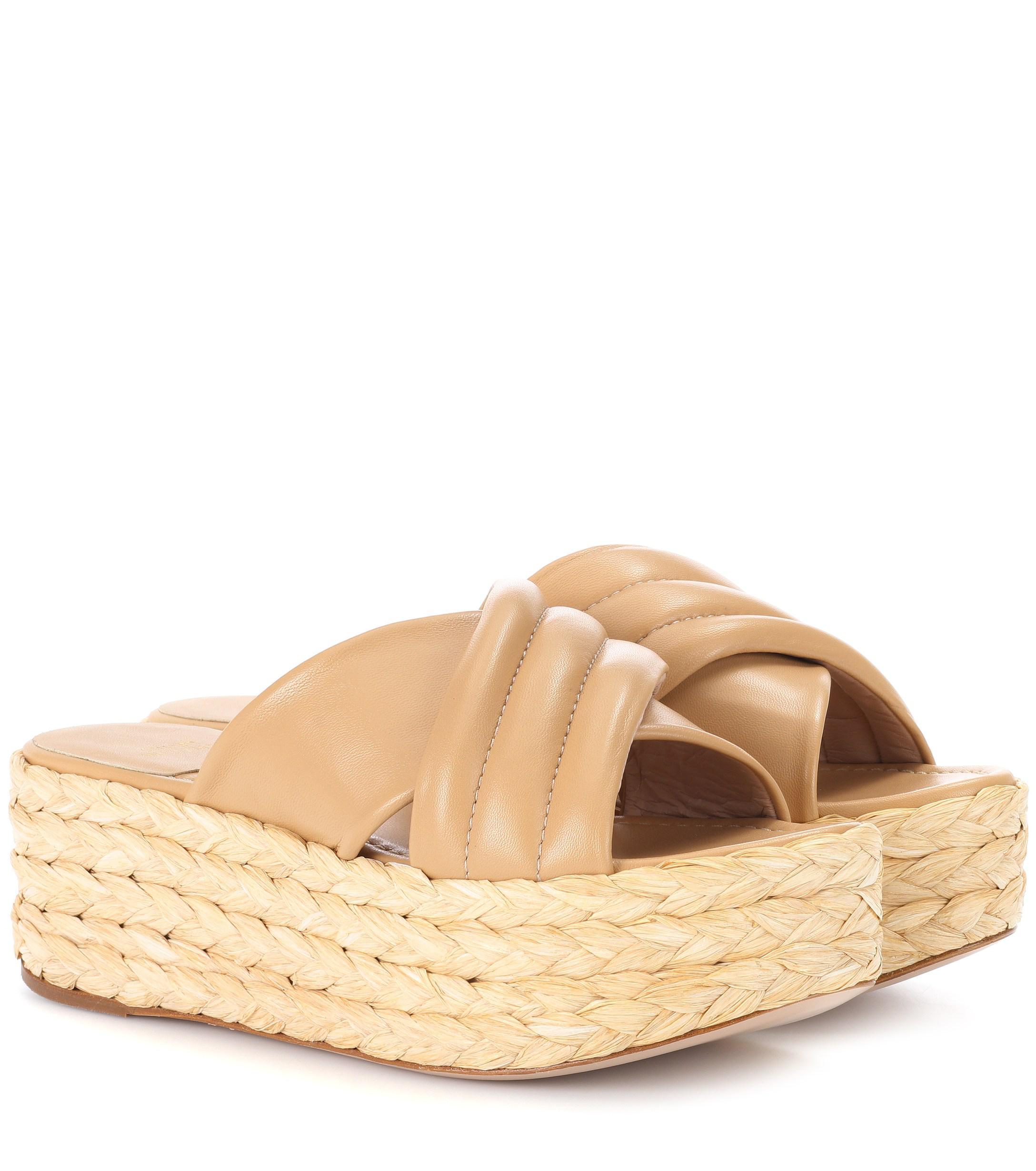 b0f1b9fa2c7 Lyst - Stuart Weitzman Pufftopraffia Leather Platform Sandals in Natural