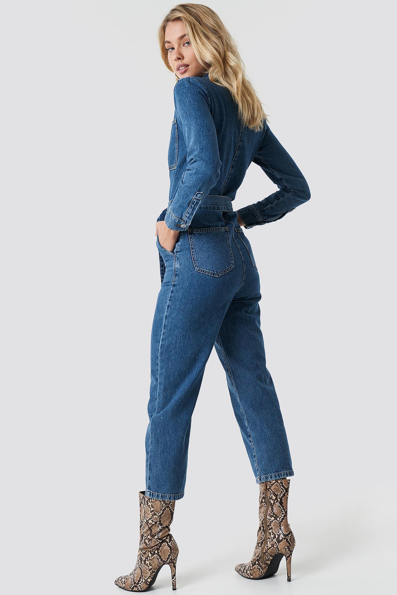 562a7ca1610e ... Waist Belt Denim Jumpsuit Blue - Lyst. View fullscreen
