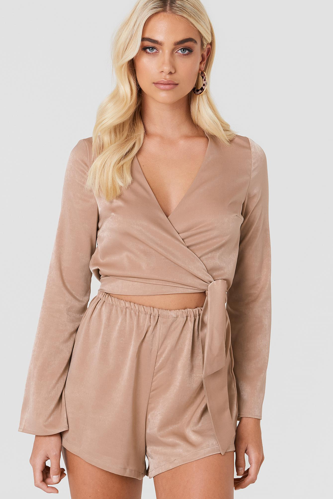 3eccbbd1fb Lyst - NA-KD Wrapped Trumpet Sleeve Playsuit Beige in Natural