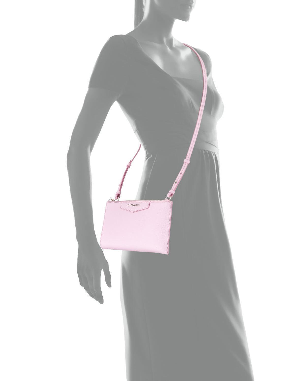 b6330ffe6d3b Lyst givenchy antigona medium crossbody pouch bag in pink jpg 1200x1500 Givenchy  navy antigona