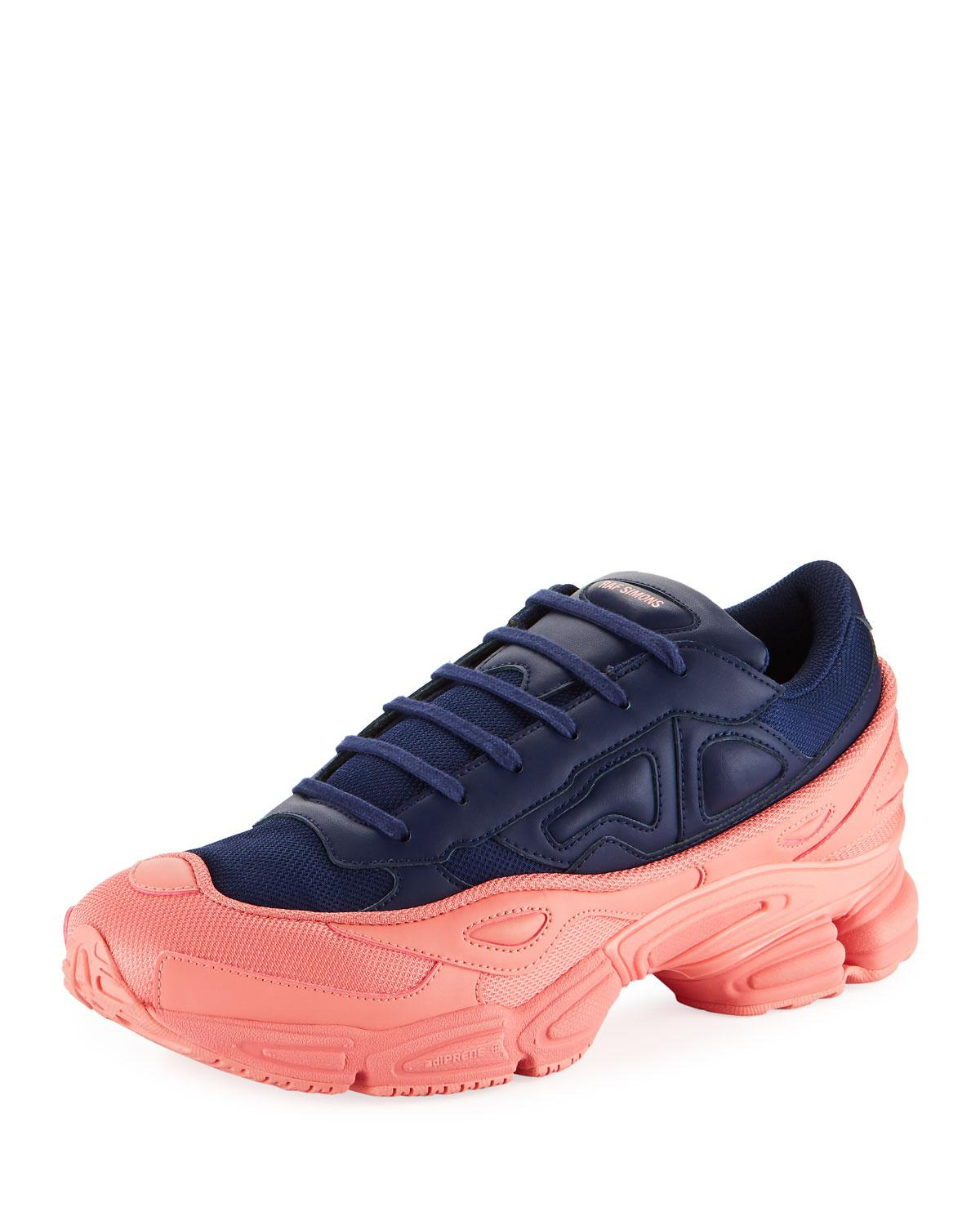 66b4813f68fe73 adidas By Raf Simons. Men s Ozweego Dipped Color Trainer Sneakers Blue pink