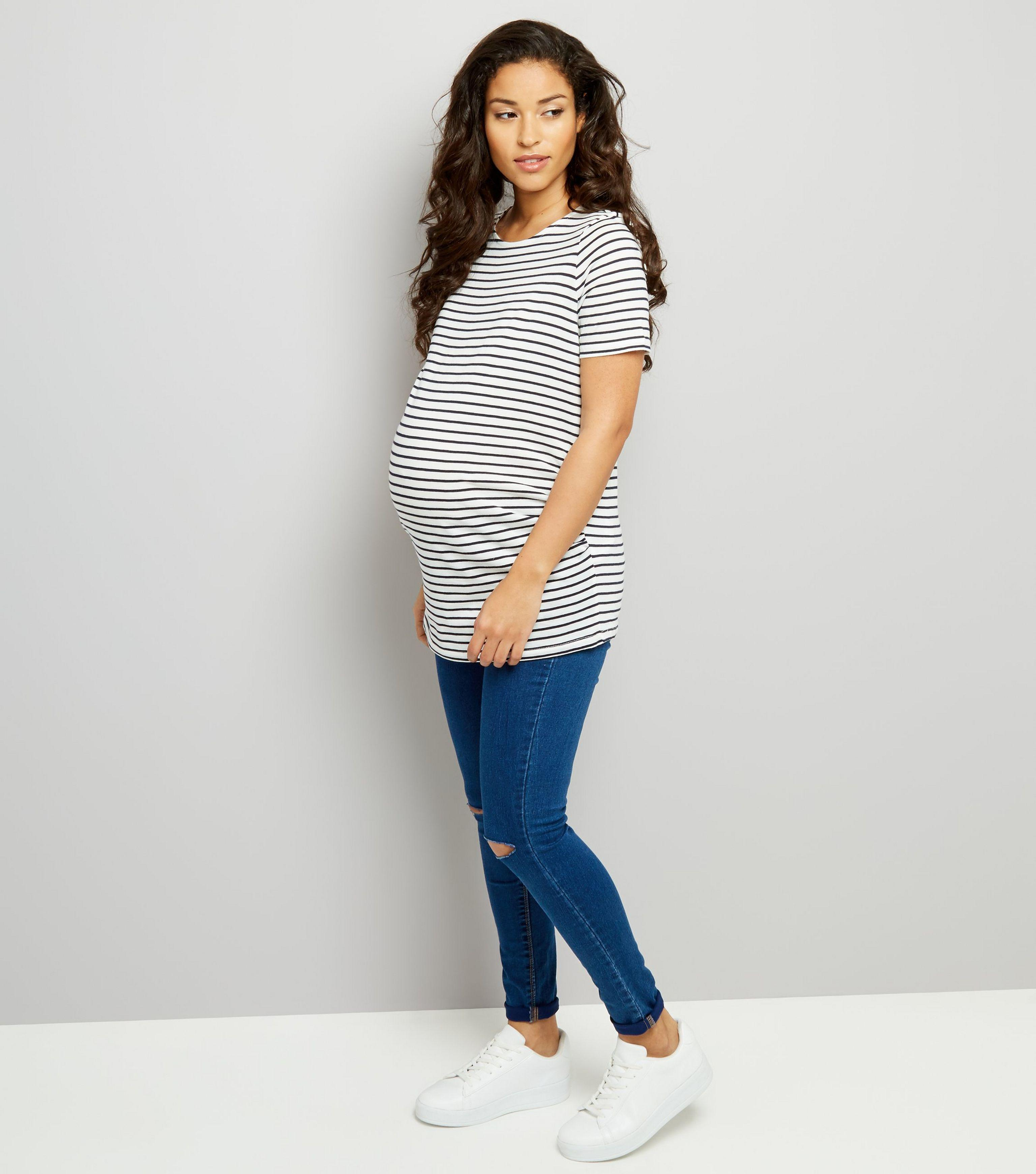 26af8655d461d New Look Maternity Blue Under Bump Ripped Knee Skinny Jeans in Blue ...