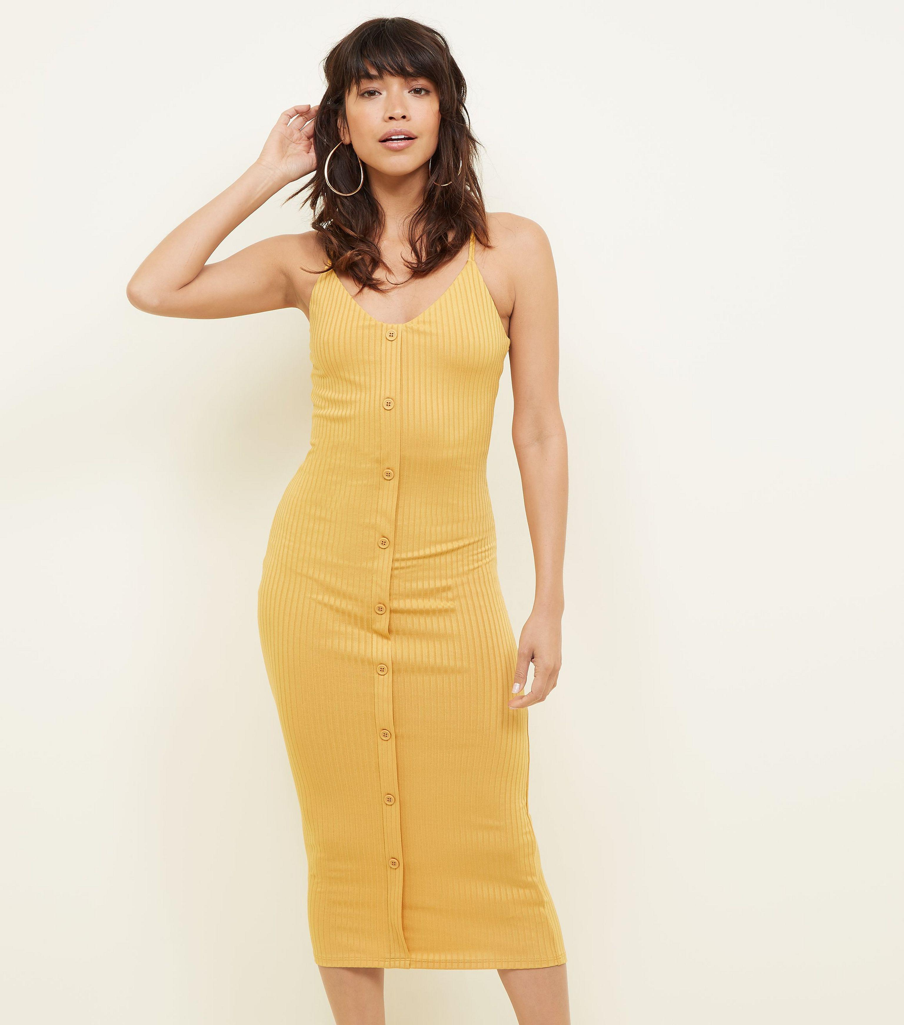 385f55c9e77 New Look Mustard Ribbed Jersey Button Front Bodycon Dress in Yellow ...