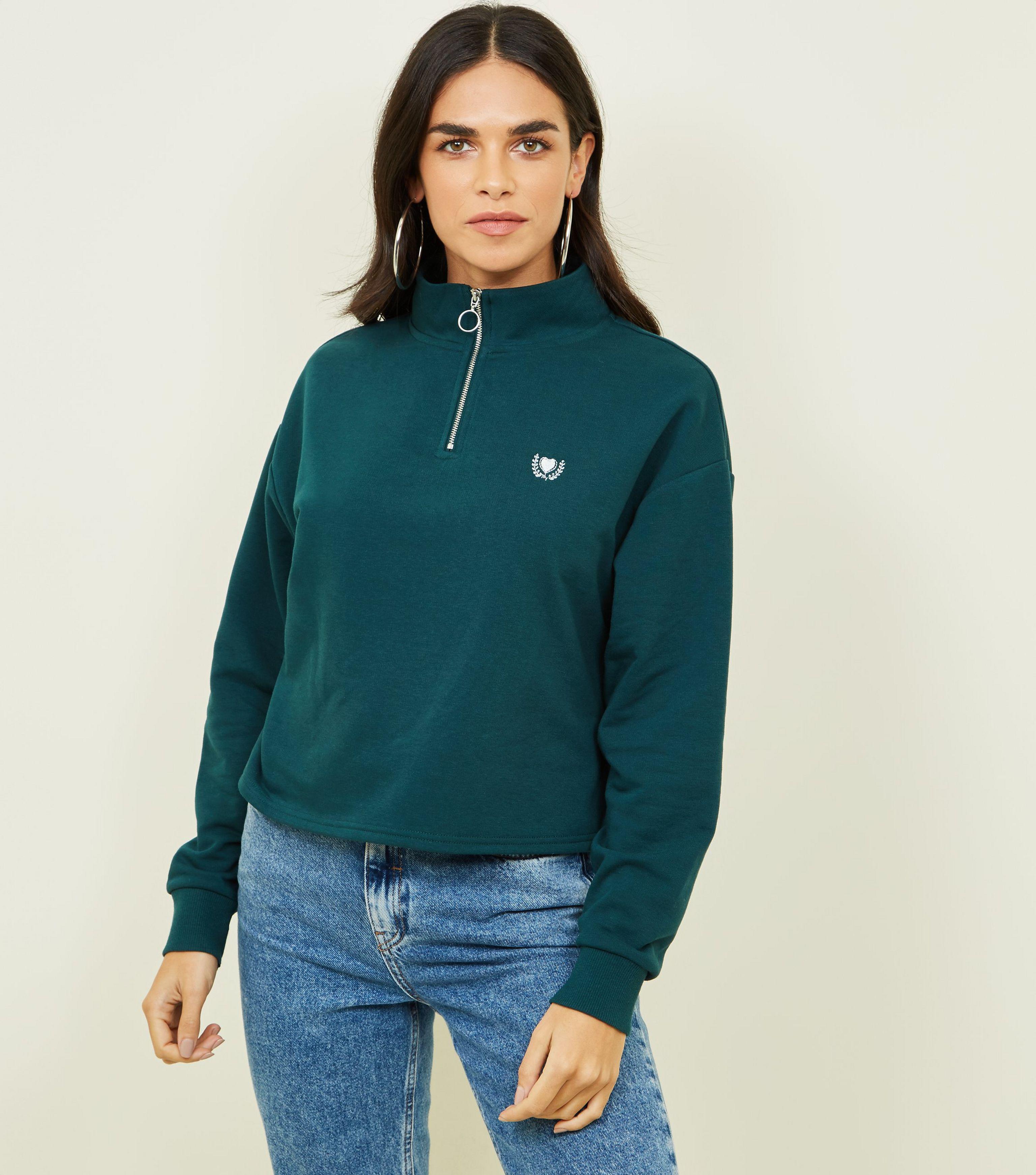 bec039a1f6a9 New Look Dark Green Heart Crest Zip Neck Sweatshirt in Green - Lyst