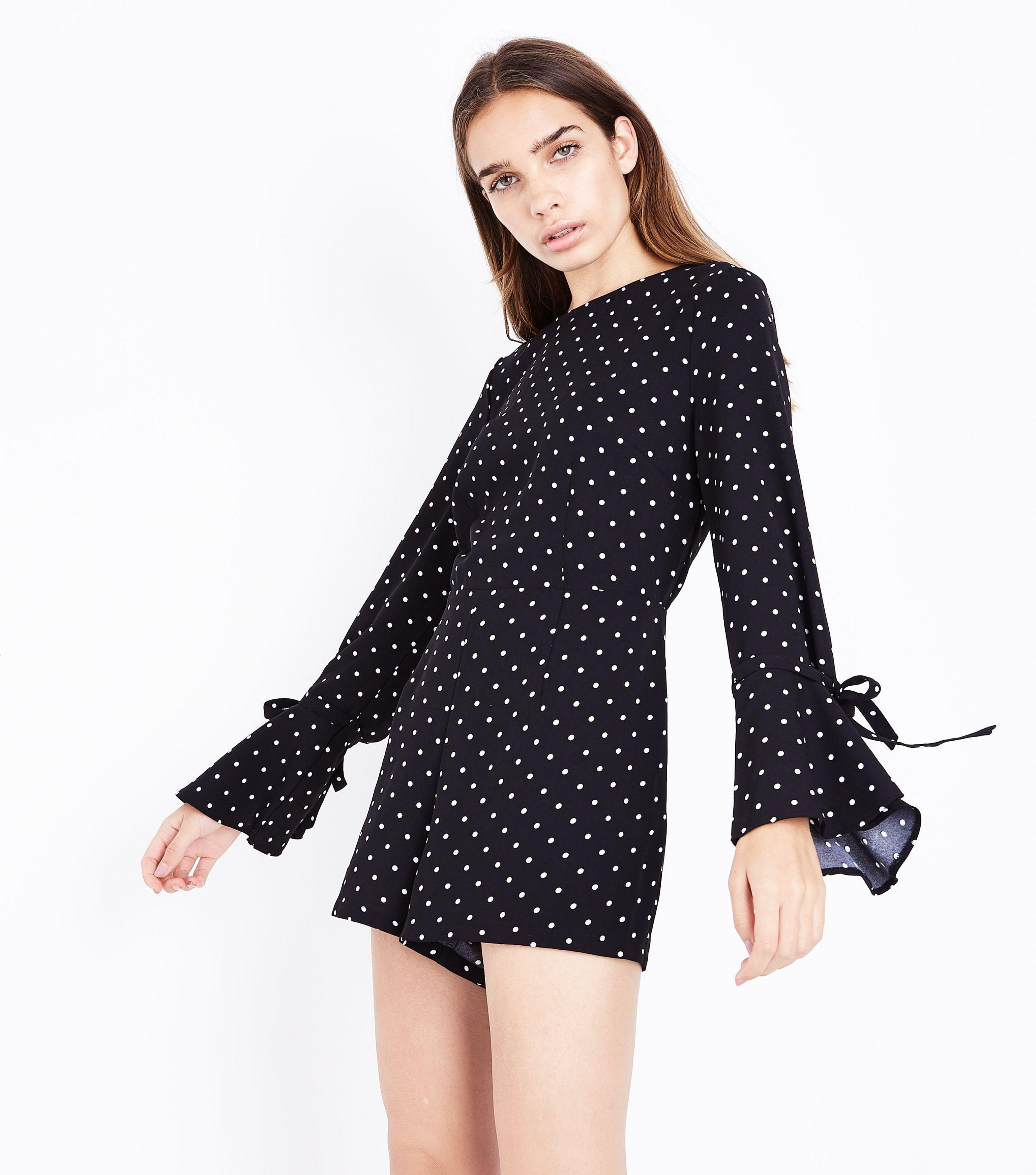 2222131a164 New Look Black Polka Dot Bell Sleeve Playsuit in Black - Lyst