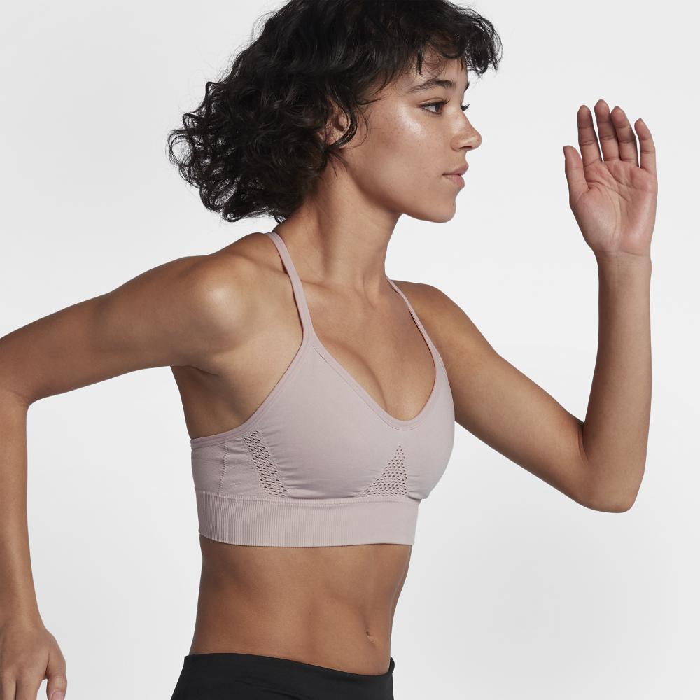 ef4f65595fc Lyst - Nike Seamless Women s Light Support Sports Bra in White