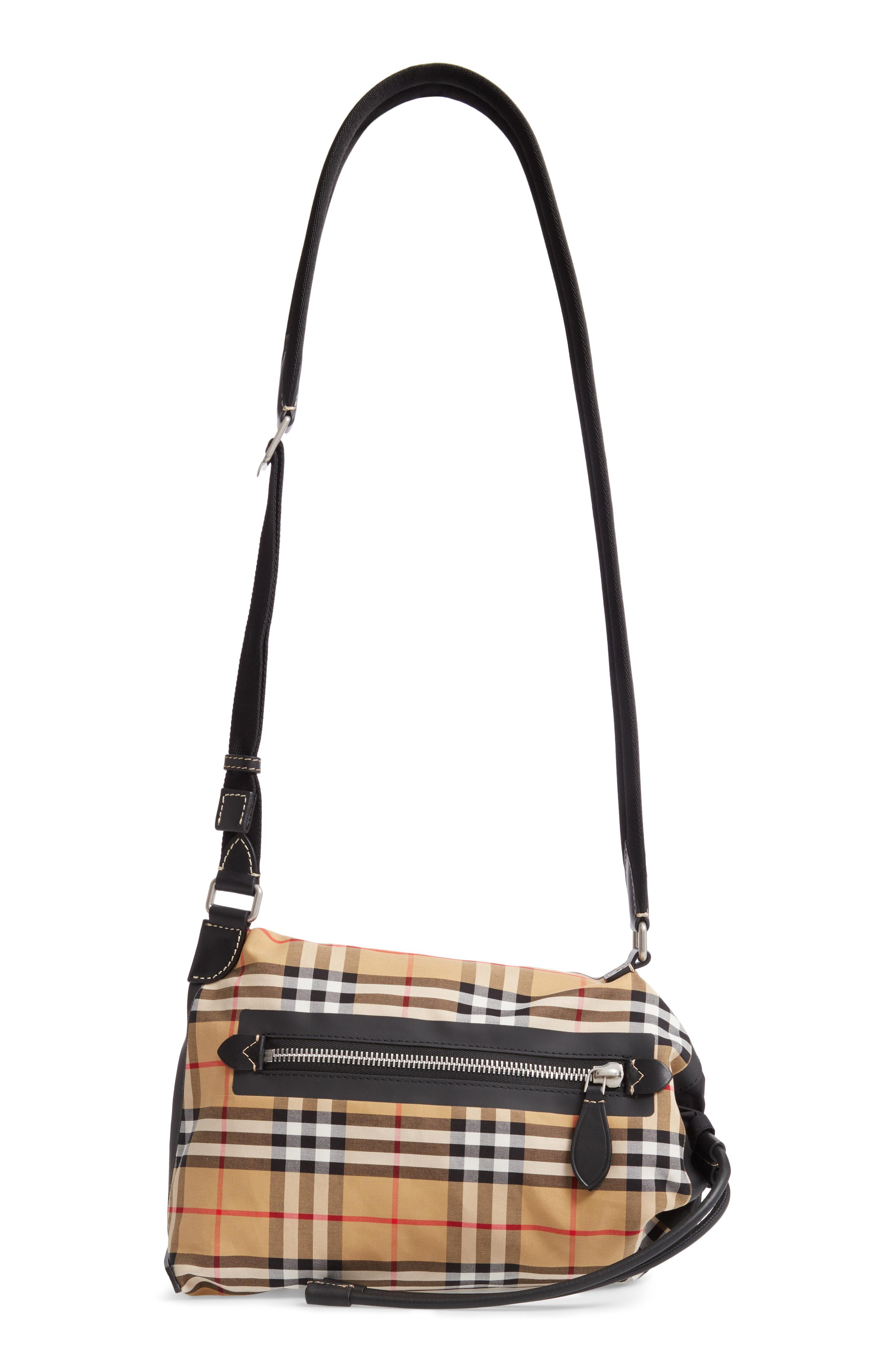 ccf91be25ed1 Burberry. Women s Small Vintage Check Sailing Duffel Sling Bag -