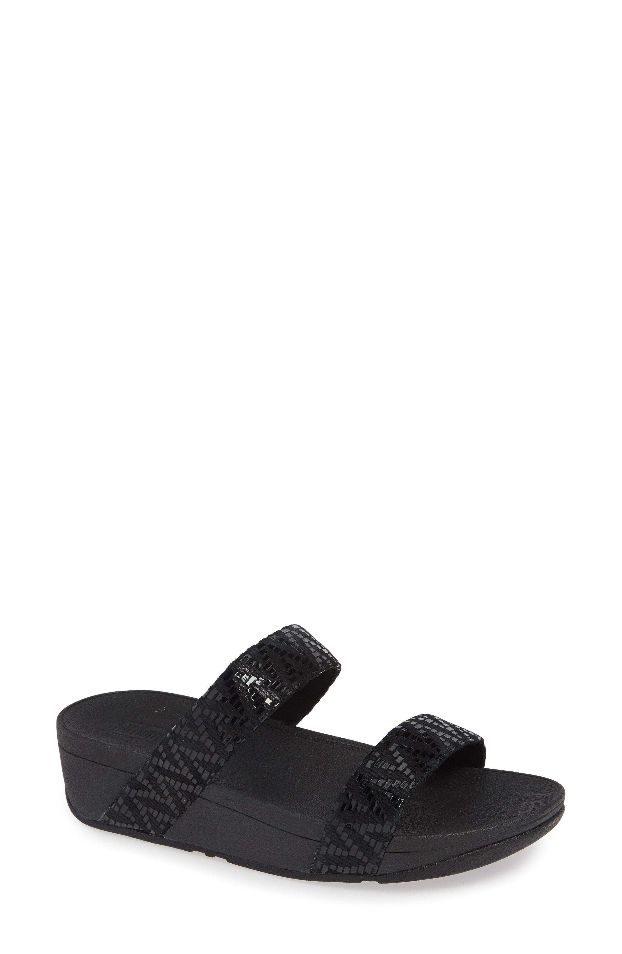 5e107183d Lyst - Fitflop Lottie Chevron Wedge Slide Sandal in Black