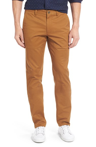Chino pants are versatile trousers crafted in durable cotton twill fabric. In the world of men's pants, they fall somewhere between casual and dressed up.