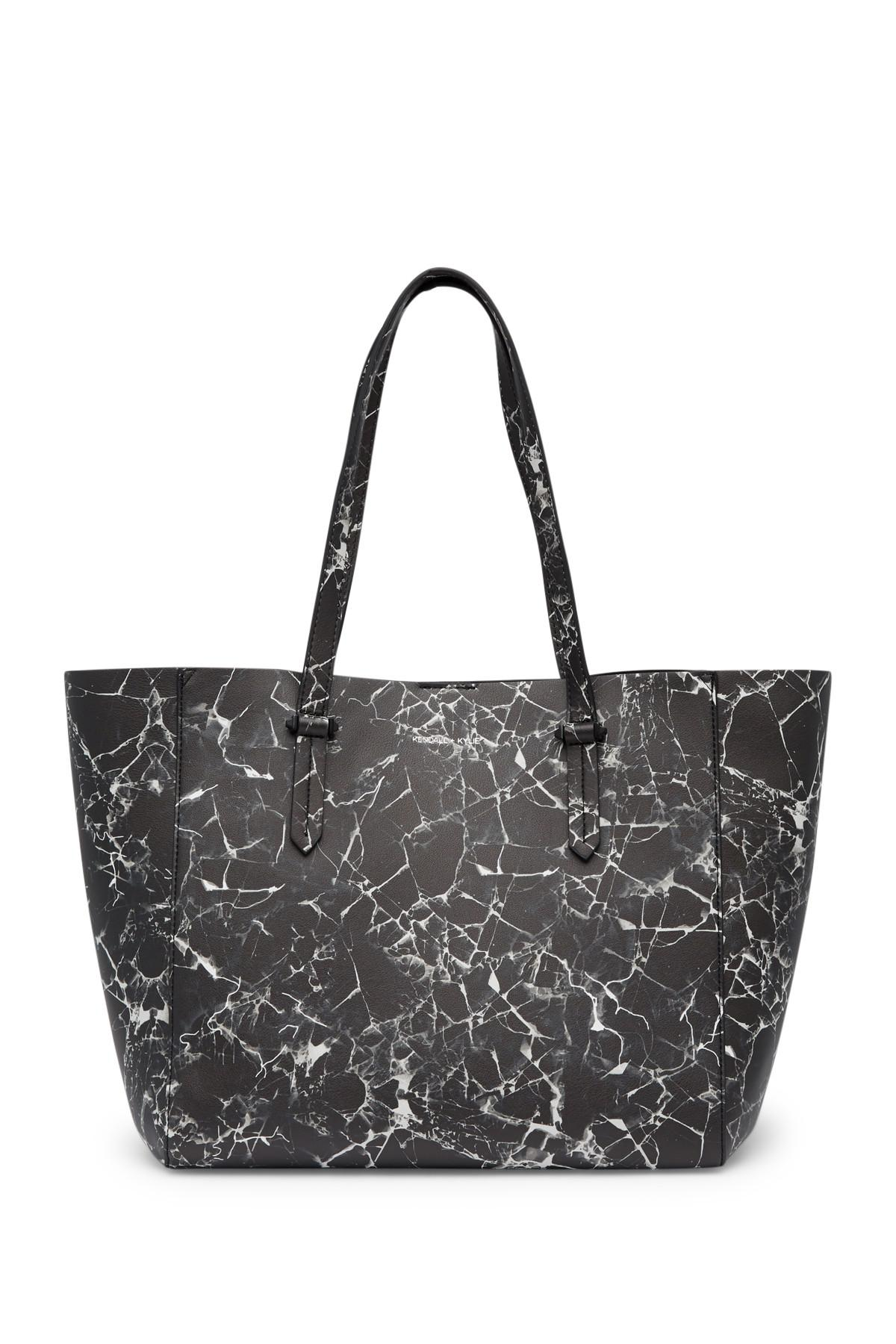 bc78af916295 Lyst - Kendall + Kylie Izzy Marble Tote Bag   Pouch in Black