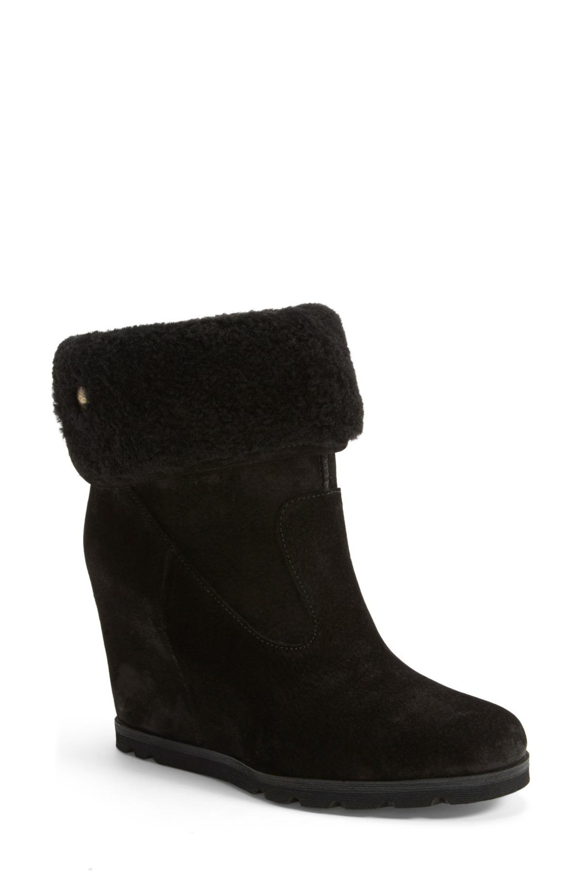 ceeb2705474 Lyst - UGG Kyra Genuine Shearling Wedge Boot in Black