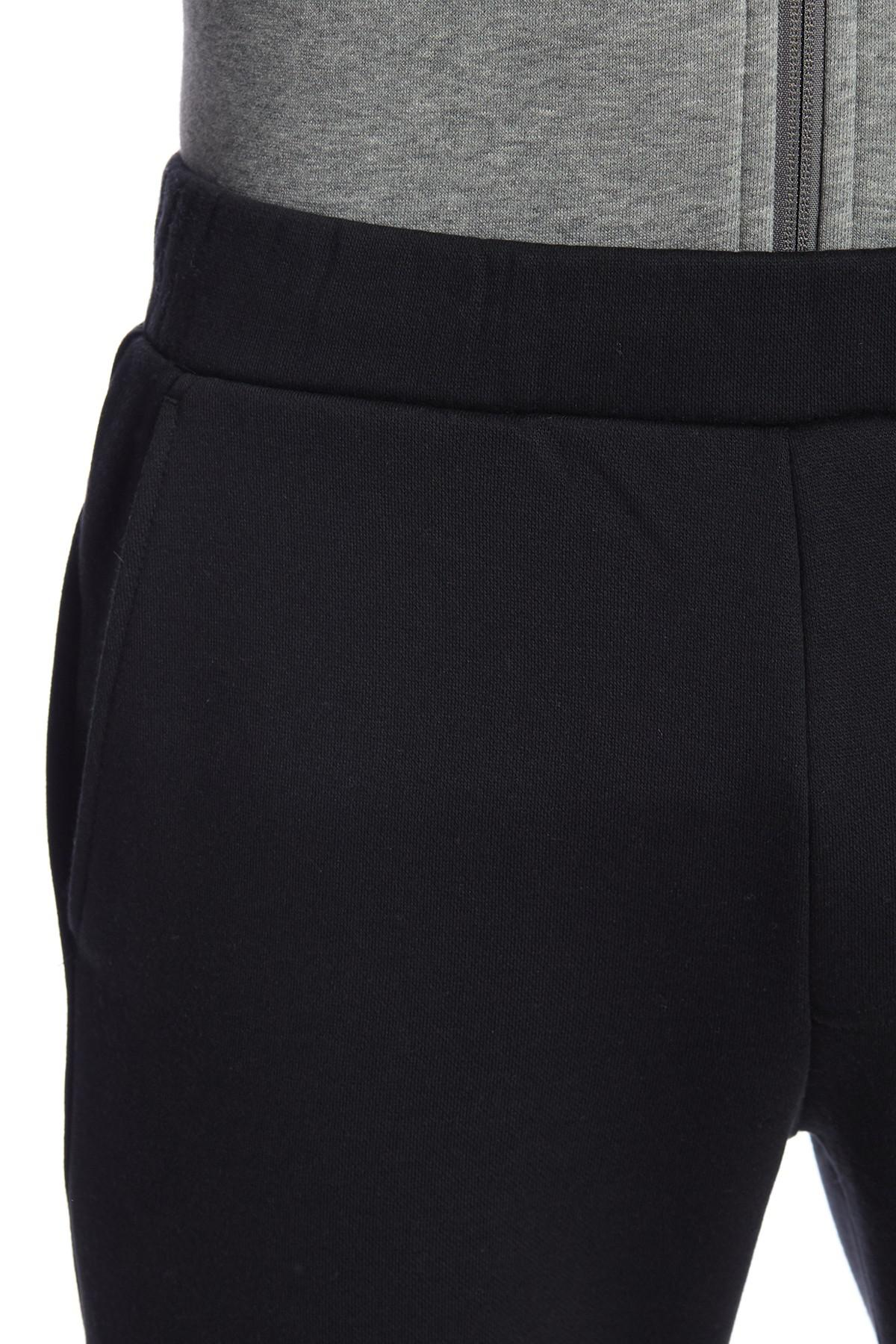4b3620feaa17 Lyst - PUMA Rebel Logo Print Sweatpants in Black for Men
