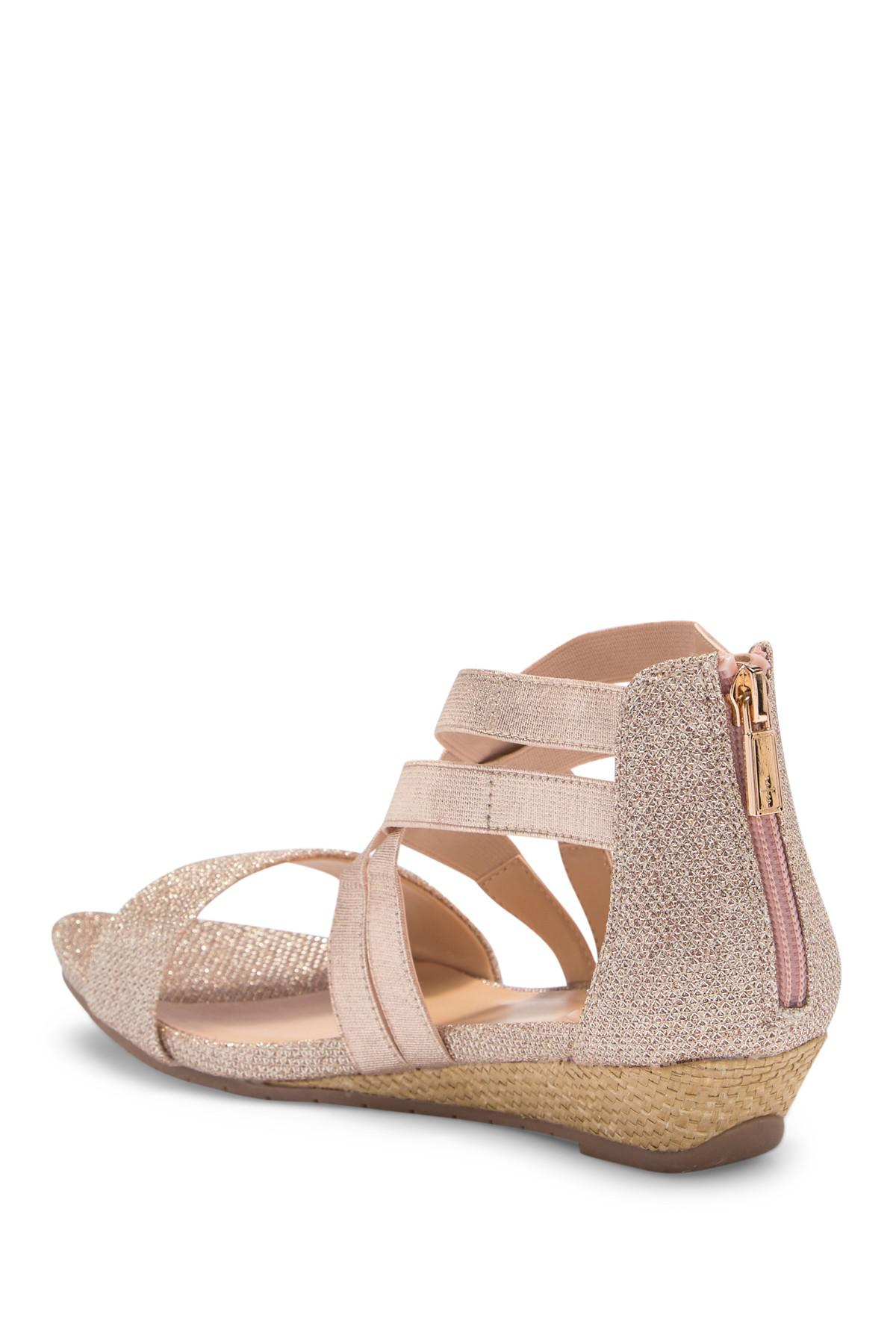 a3a8696faa Lyst - Kenneth Cole Reaction Great Stretch Wedge Sandal