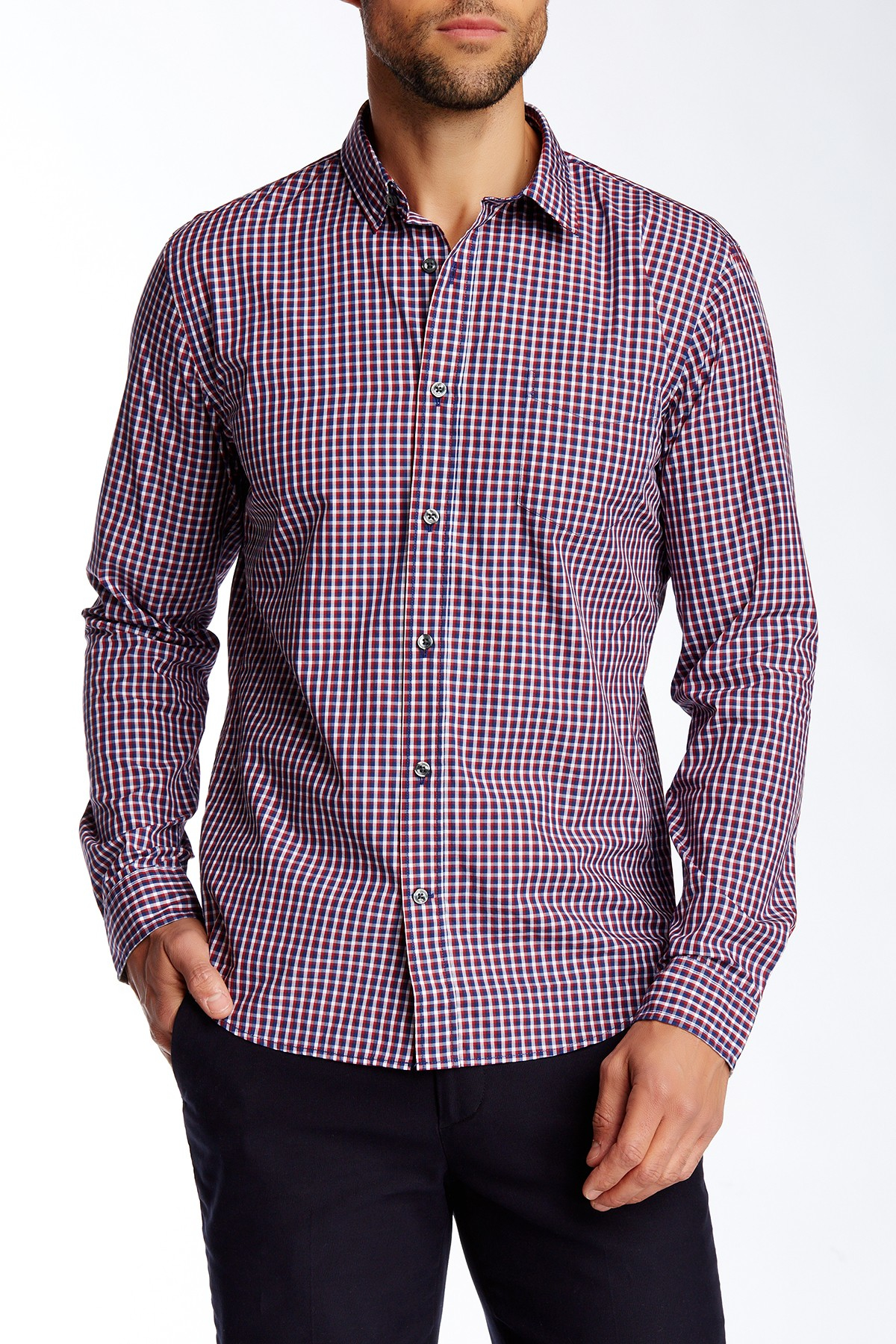 The burgundy plaid on this slim fit dress shirt by Awearness Kenneth Cole is eye-catching yet neutral enough to complement a variety of dress wear ensembles. Made with non-iron cotton it defies wrinkles for carefree all-day wear.