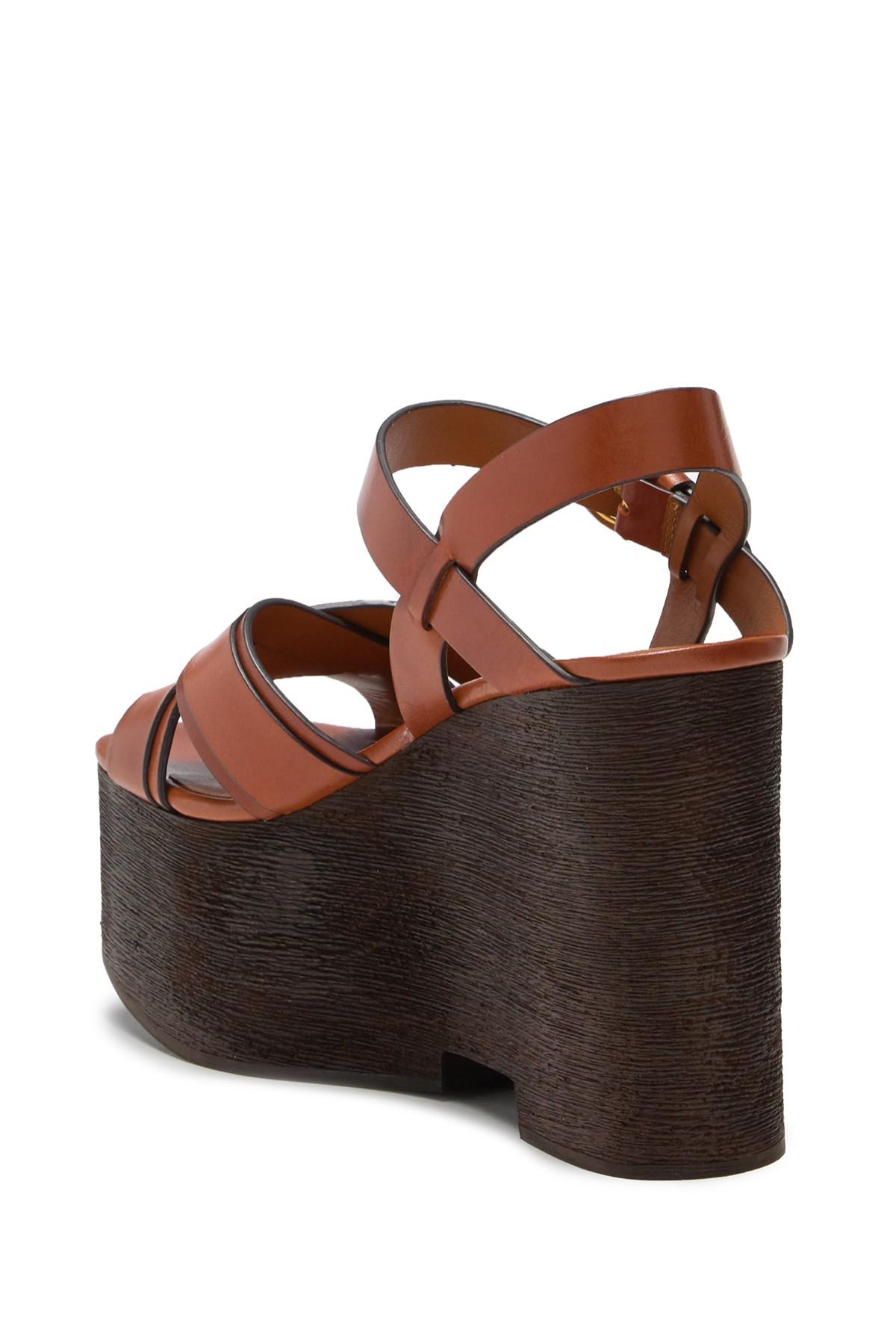 1fe7a2558573 ... Brown Paloma Status Leather Wedge Sandal - Lyst. View fullscreen