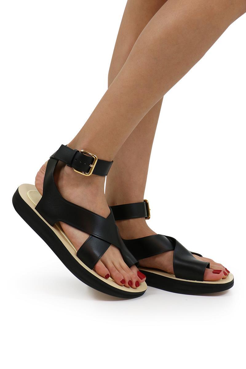 0b1c850ae4a8e3 Lyst - Céline Flat Toe Ring Sandal Black in Black