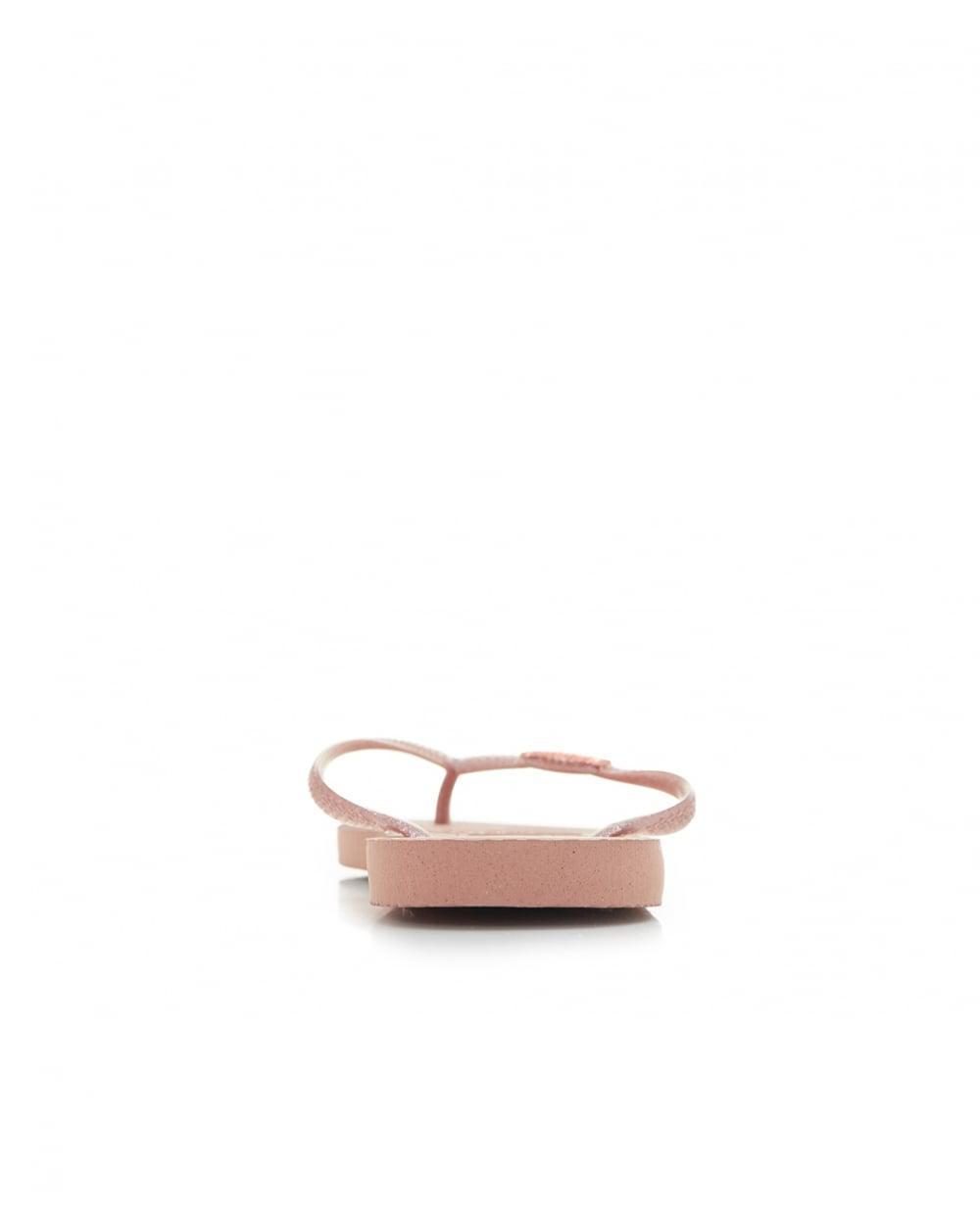 2153b9cceb79e Lyst - Havaianas Slim Logo Metallic Flip Flops in Pink - Save 42%