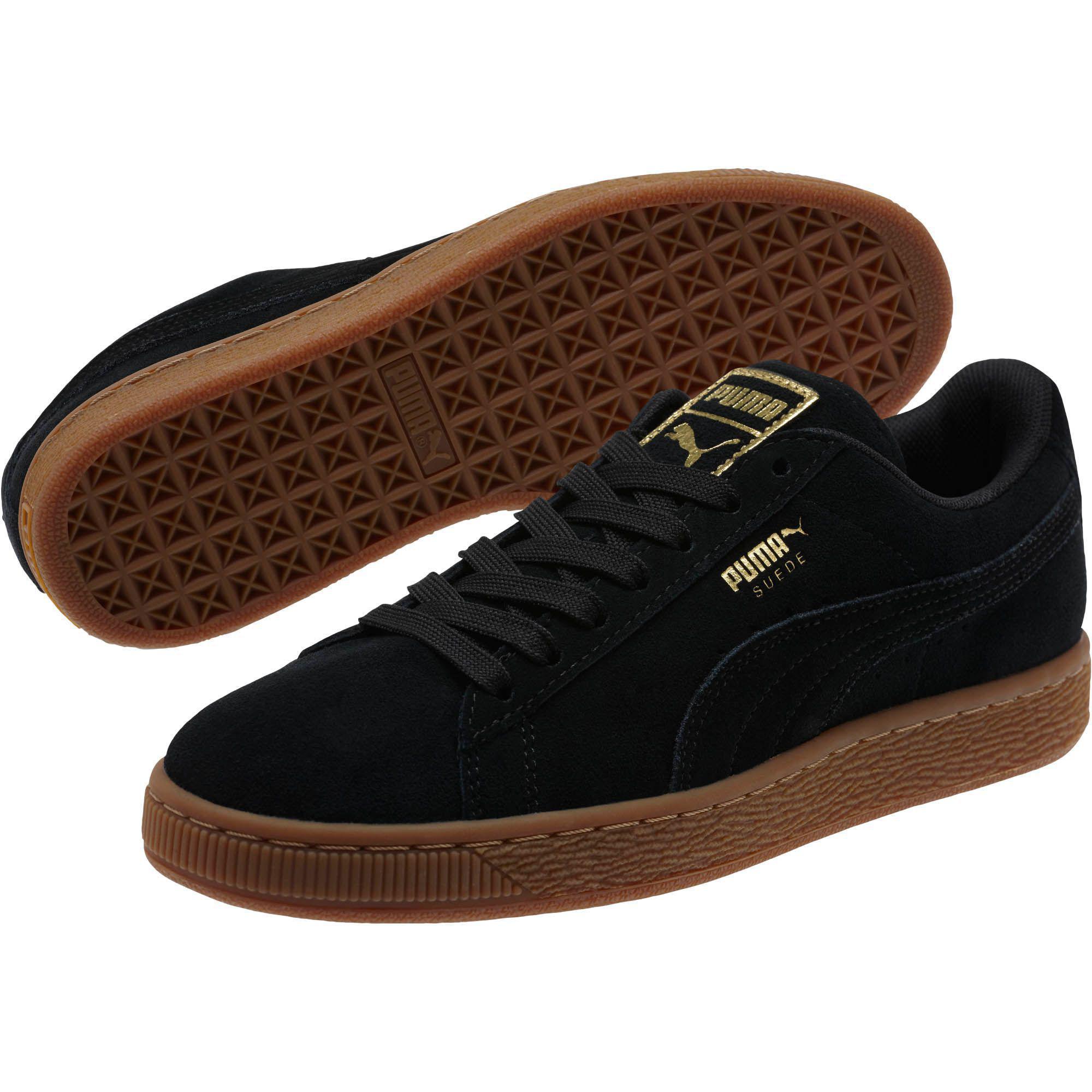Lyst - PUMA Suede Classic Gold Women s Sneakers in Black ba2a6daa64