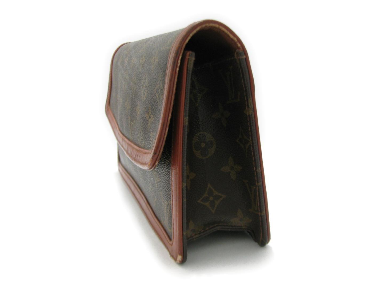 106f1136c6ae Lyst - Louis Vuitton Pochette Dame Gm Monogram Hand Clutch Bag ...