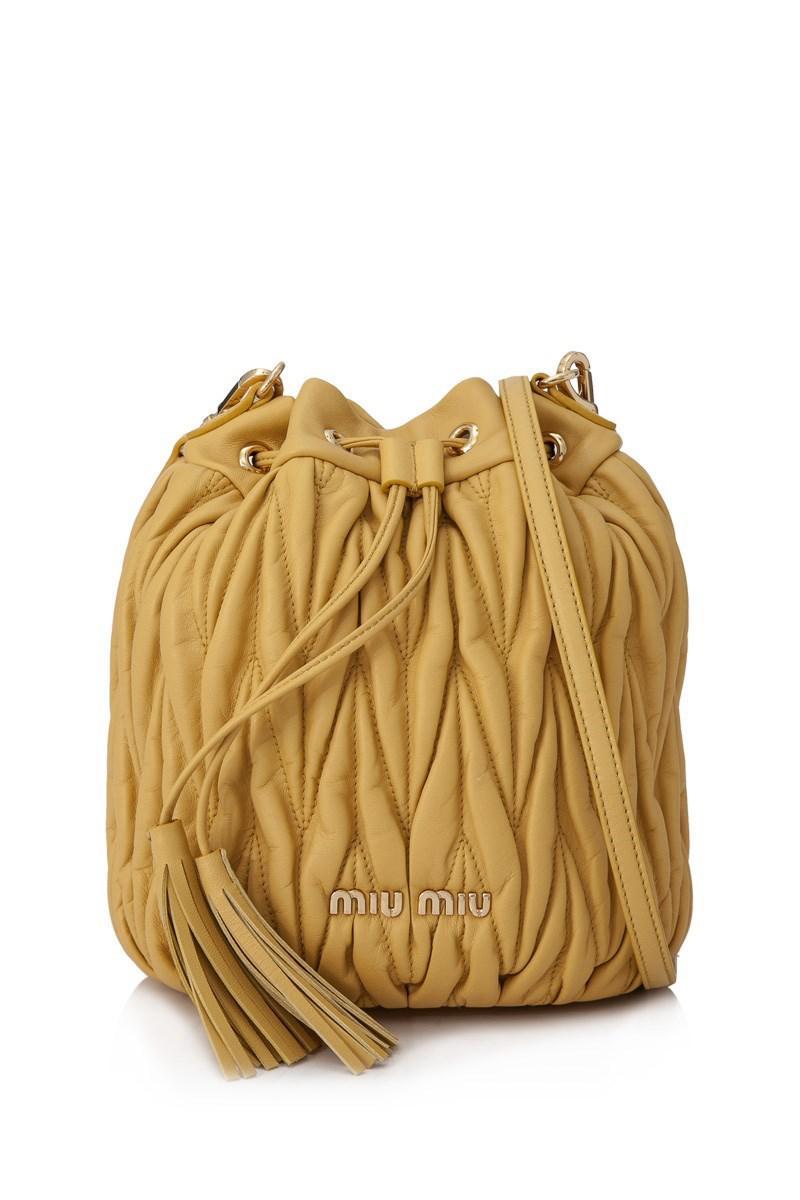 7055ad69e60d Lyst - Miu Miu Matelasse Bucket Bag in Yellow