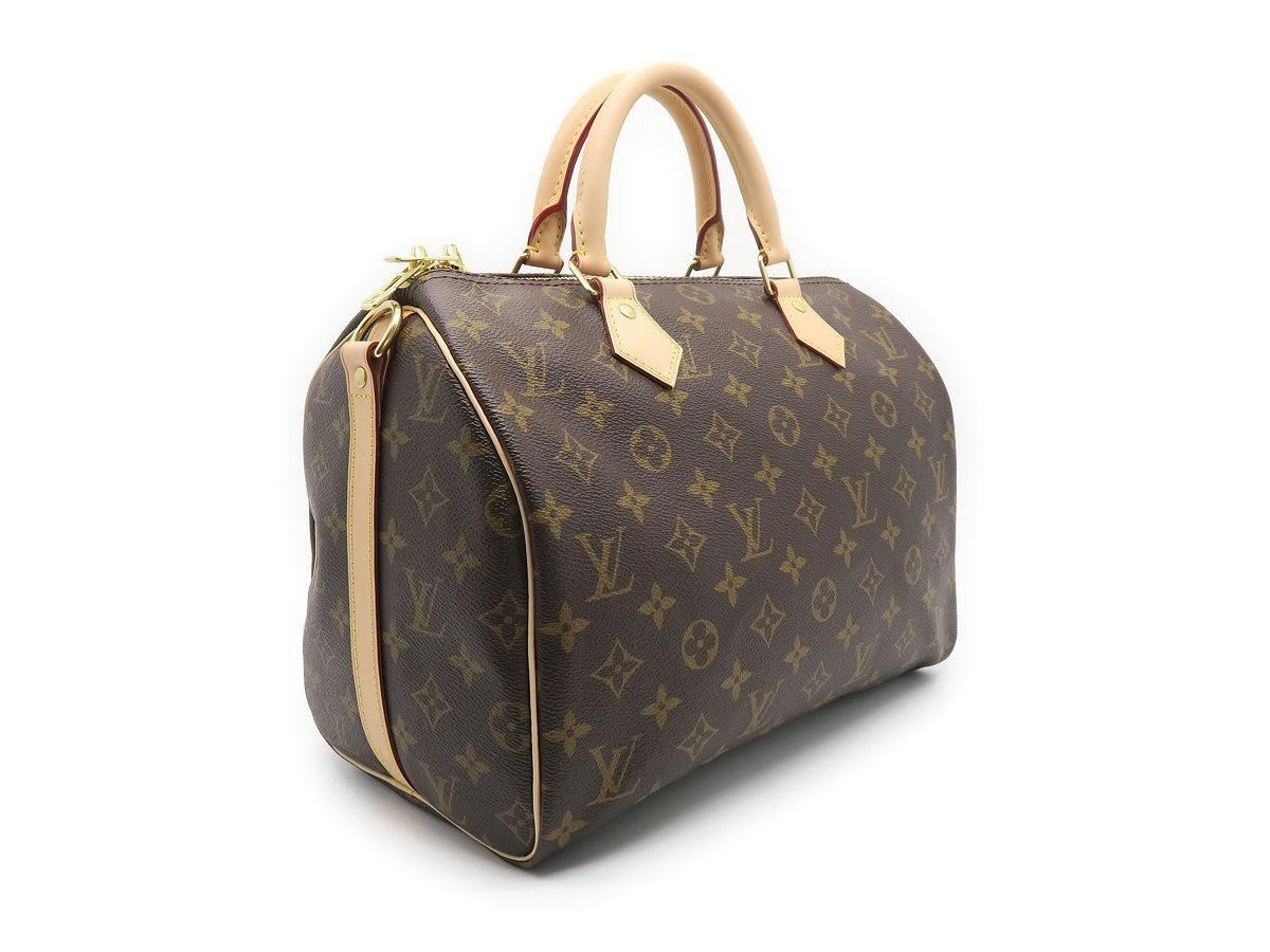 ba7ff7ba190f Lyst - Louis Vuitton Monogram Speedy 30 Bandouliere Satchel Bag ...