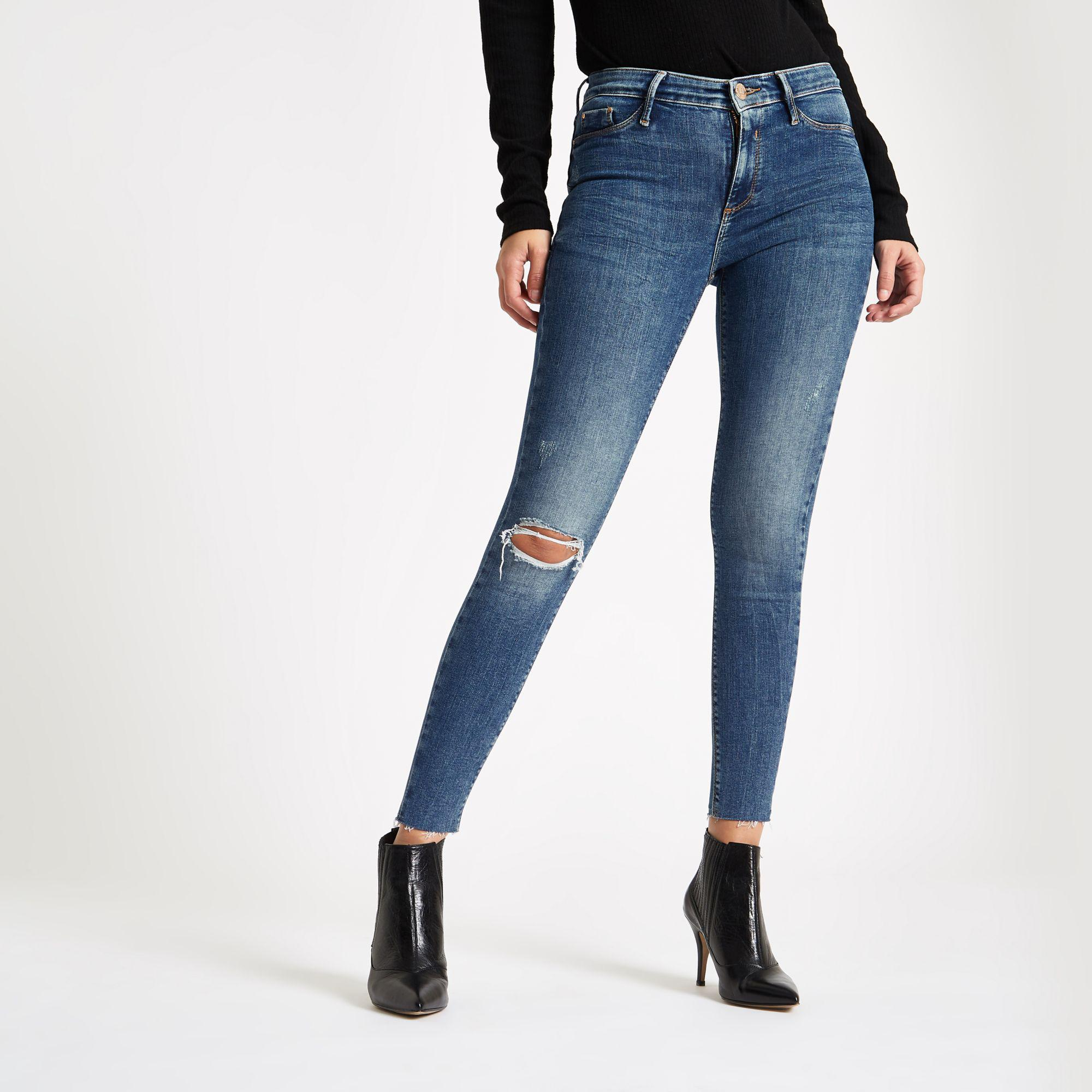 0f94c0deeb54a Lyst - River Island Mid Blue Molly Mid Rise Ripped jeggings in Blue