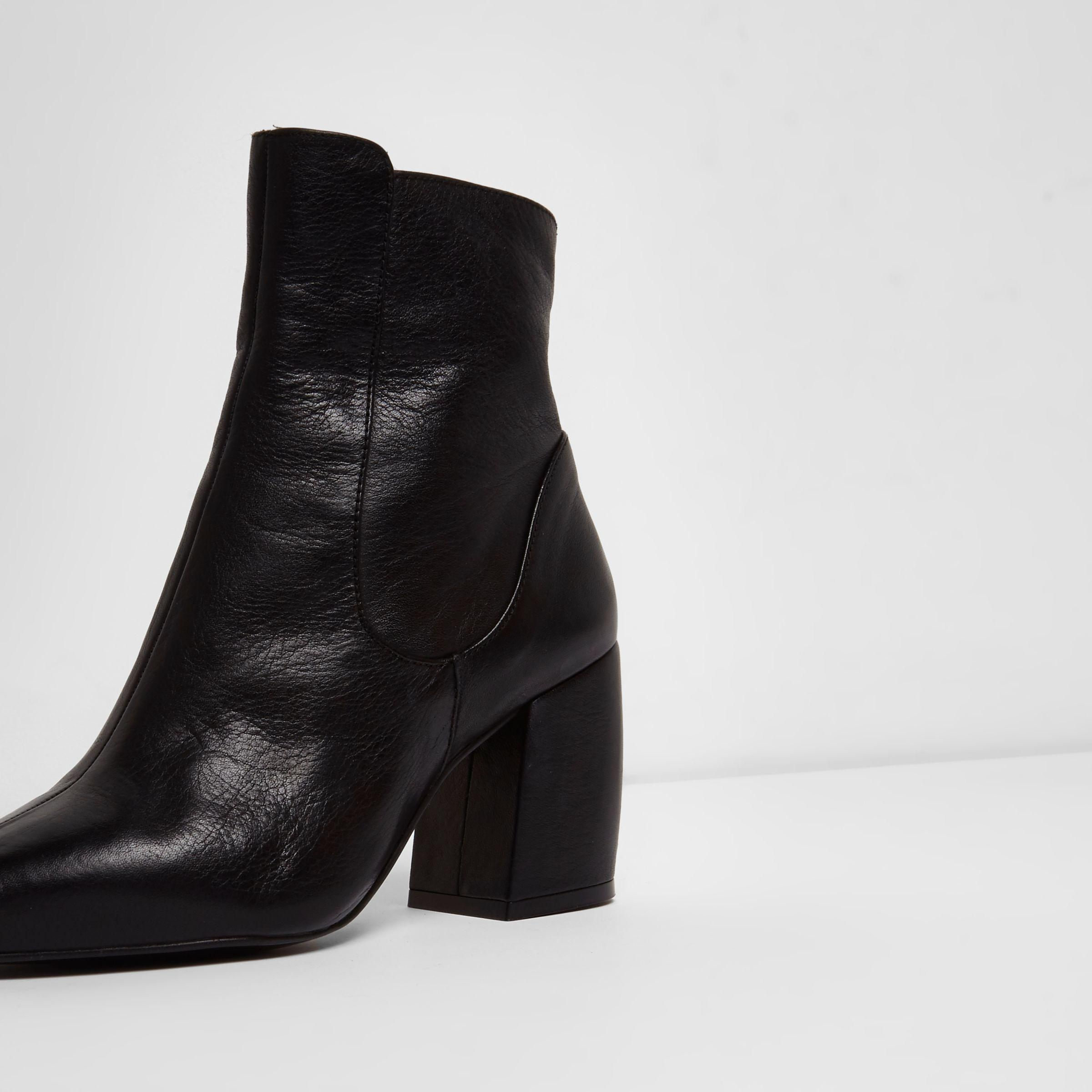 605f865383d3 River Island Black Leather Curved Heel Pointed Ankle Boots in Black ...