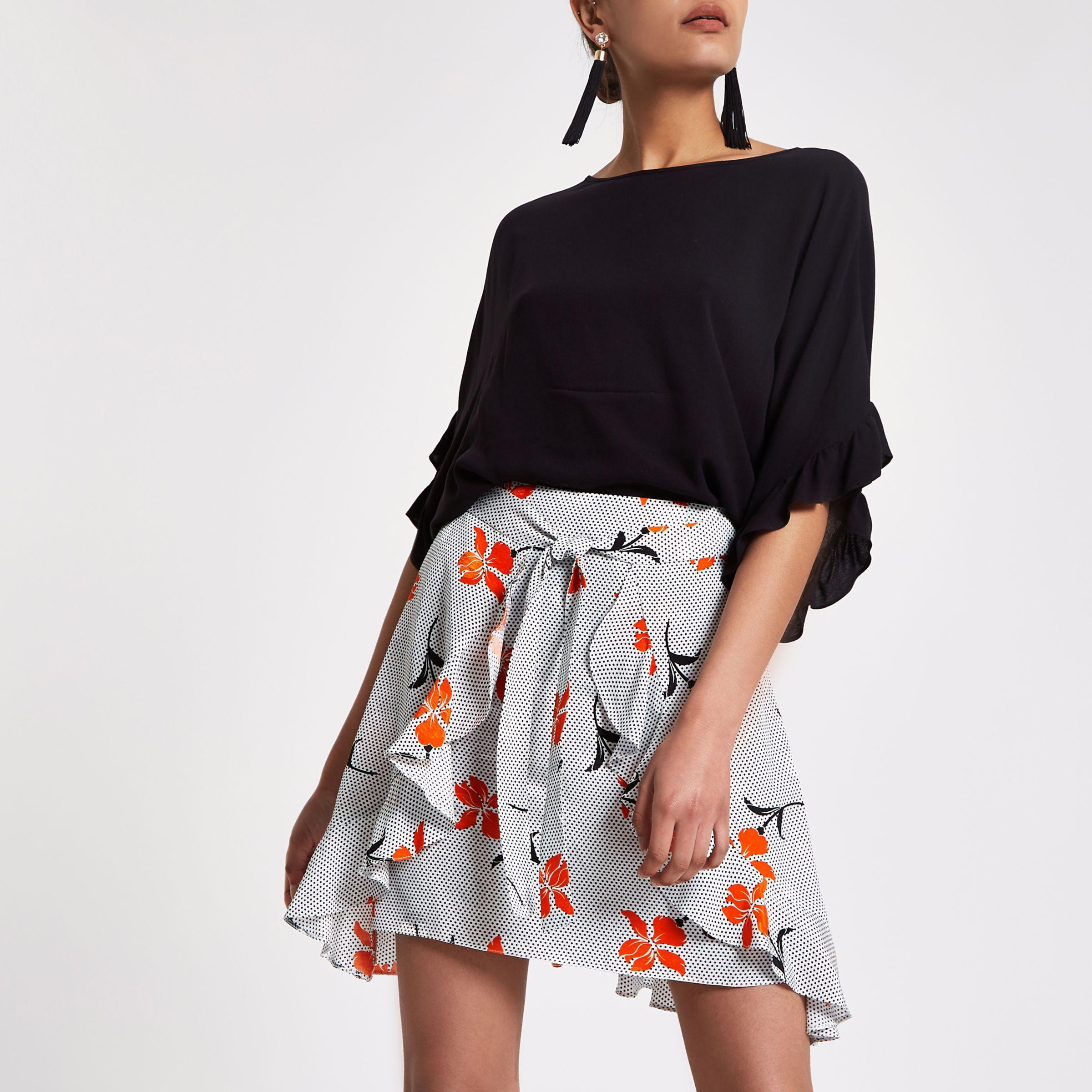 79efb4982 River Island Black Floral Spot Wrap Tie Front Mini Skirt in Black - Lyst