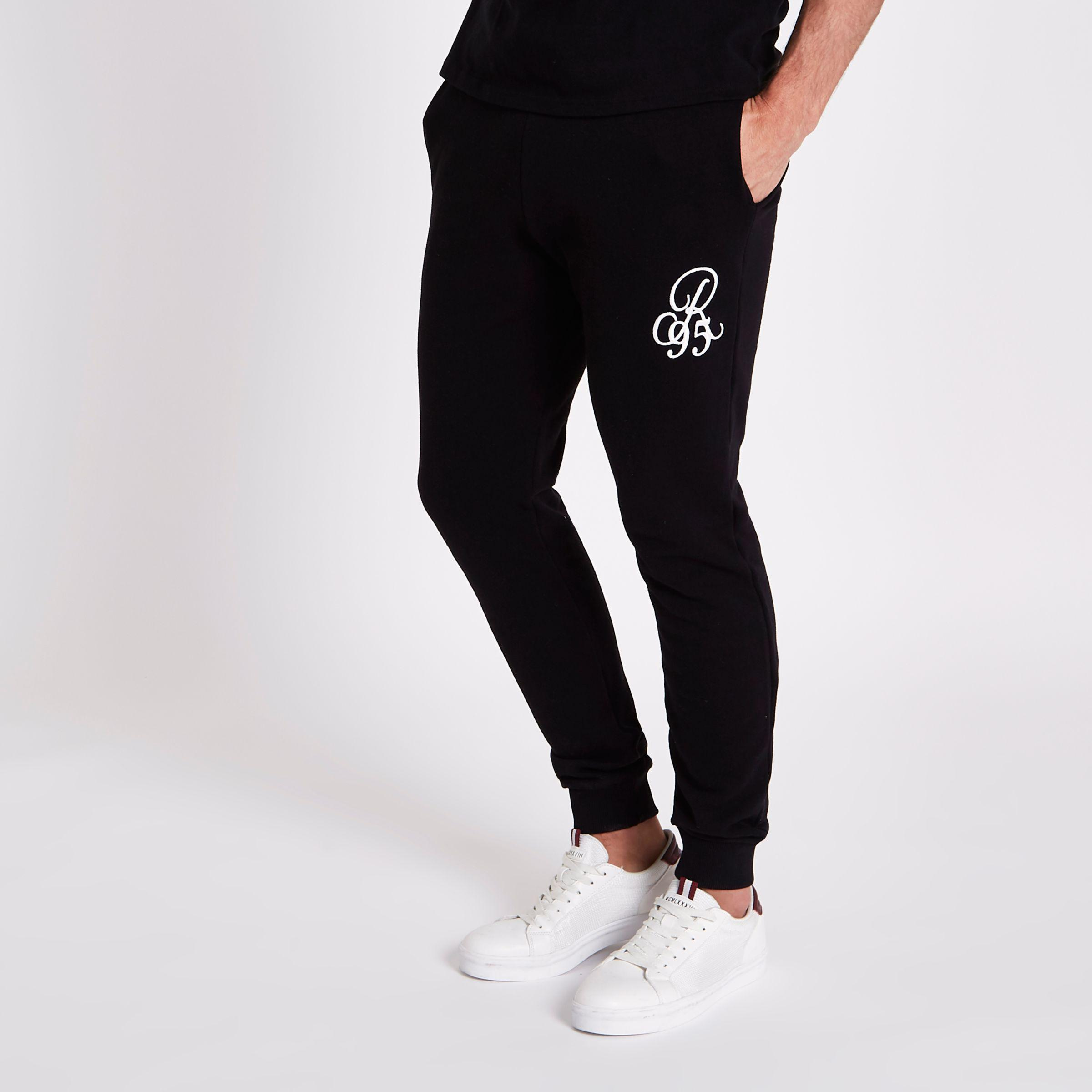 Clearance New Best Supplier Mens Black muscle fit R95 embroidered joggers River Island 100% Authentic Online Discount For Nice Footlocker Cheap Online KJMgiJE