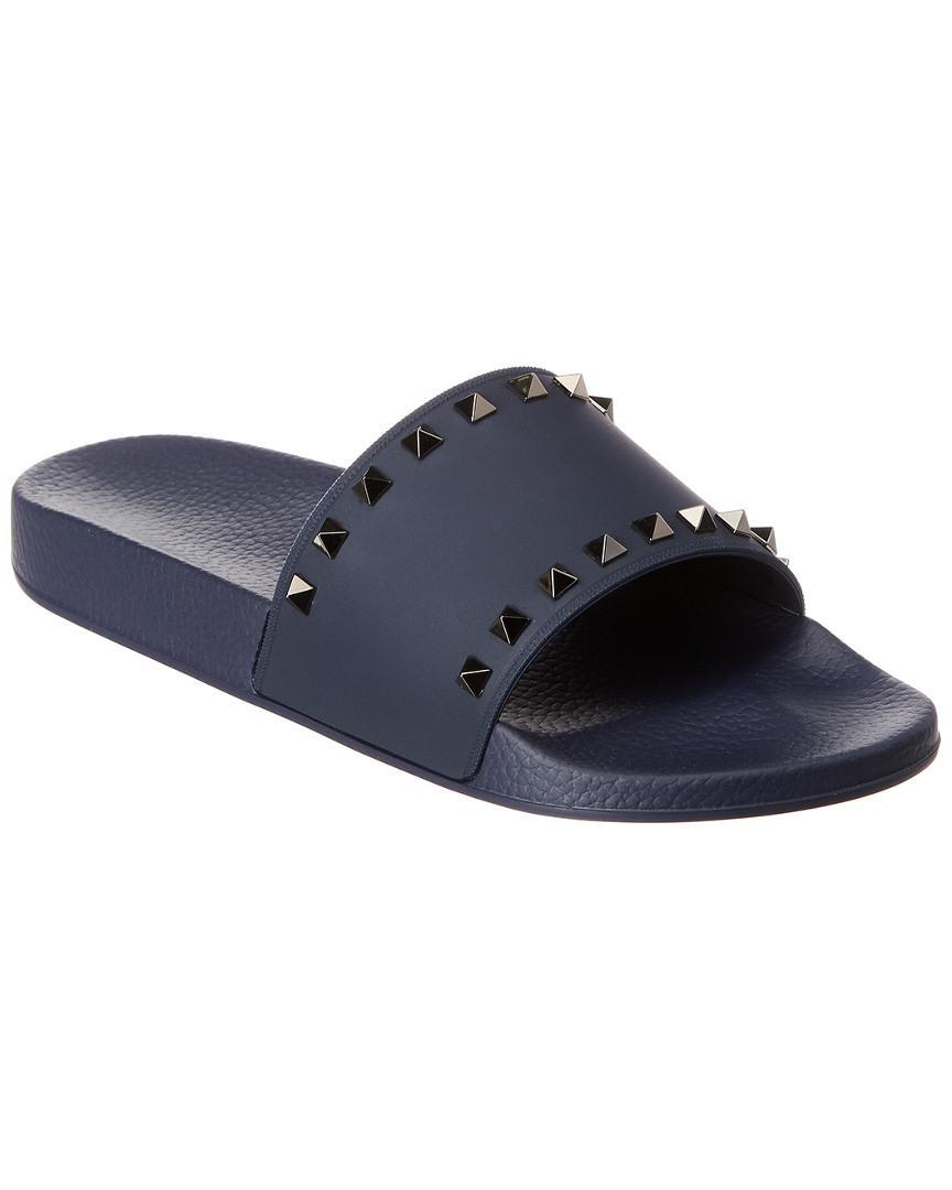25e1c4b0077b Lyst - Valentino Garavani Rockstud Rubber Slides in Blue for Men ...