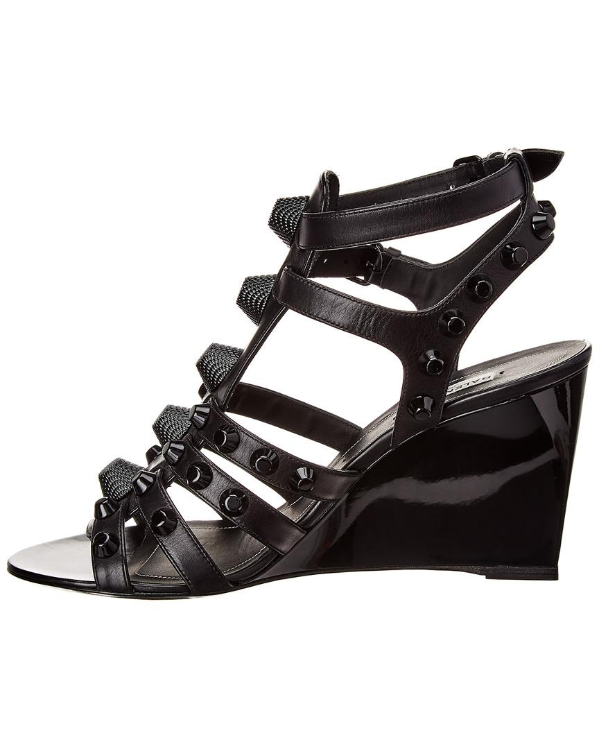 ab01b5e66dc5 Lyst - Balenciaga Studded Leather Wedge Sandal in Black