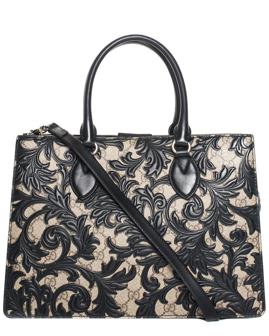 29e7f17c4925 Lyst - Gucci Brown GG Supreme Canvas   Black Leather Arabesque Tote ...