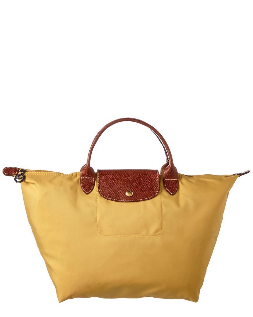 Longchamp Le Pliage Medium Nylon Top Handle Tote in Yellow - Save ... 186228eb4e380