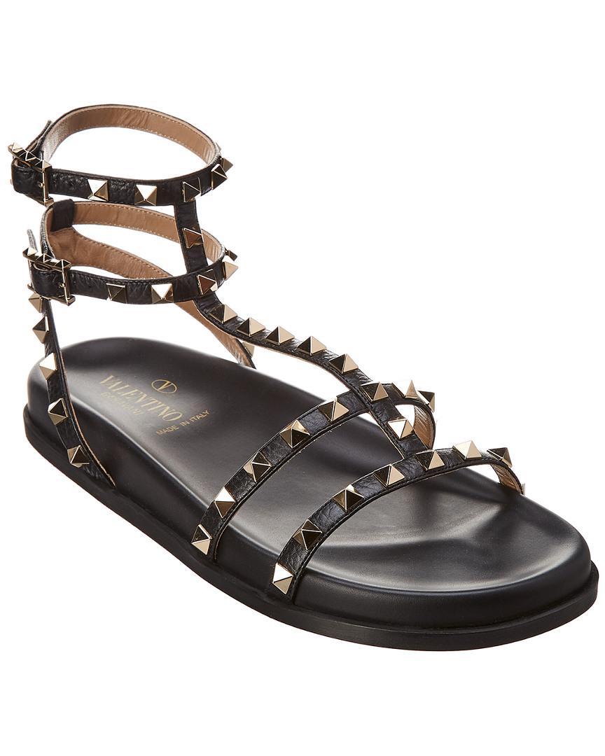 48541821ab0dda Valentino Rockstud Gladiator Leather Sandal in Black - Lyst