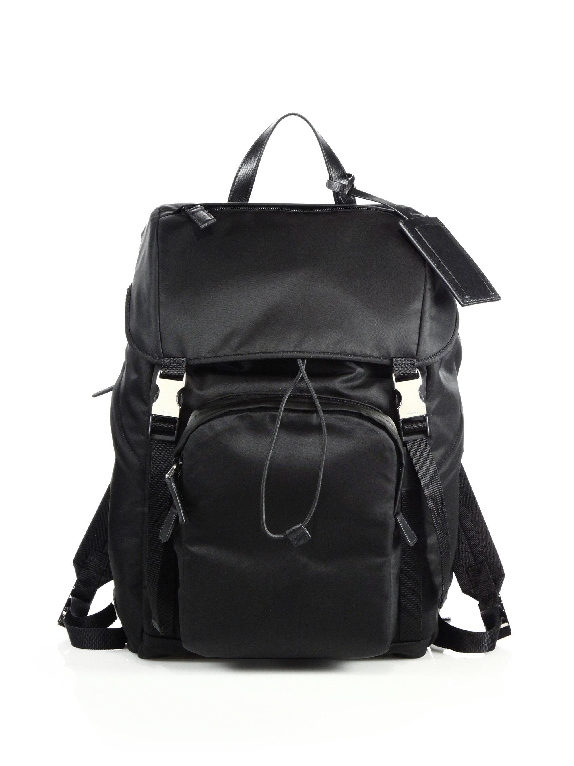3c7a8a1037c5 Prada Large Tessuto Impunturato Backpack - Bergdorf Goodman. Prada quilted  nylon backpack with leather trim.