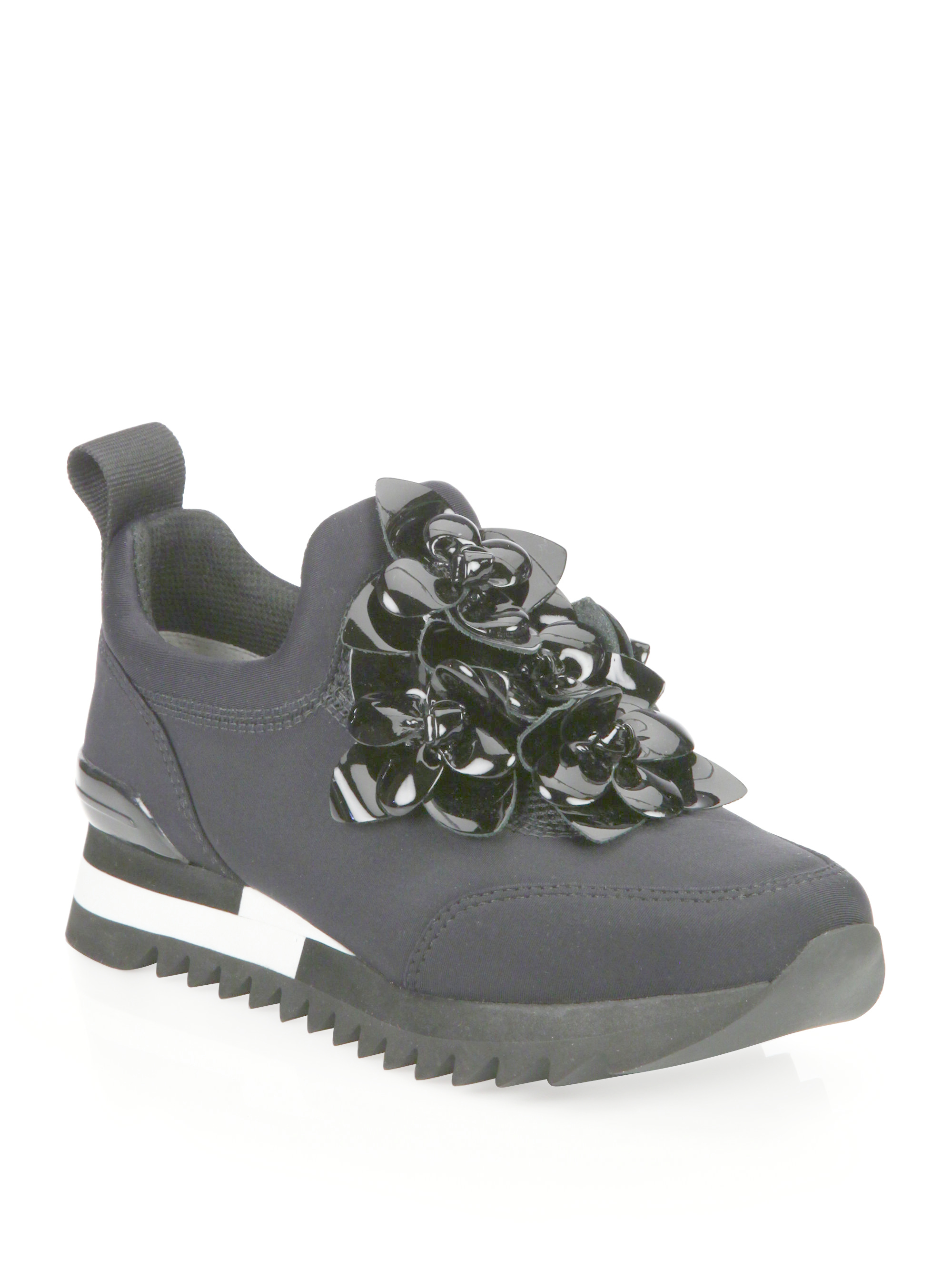 27a82fa7ff1e7 Lyst - Tory Burch Blossom Neoprene Sneakers in Black