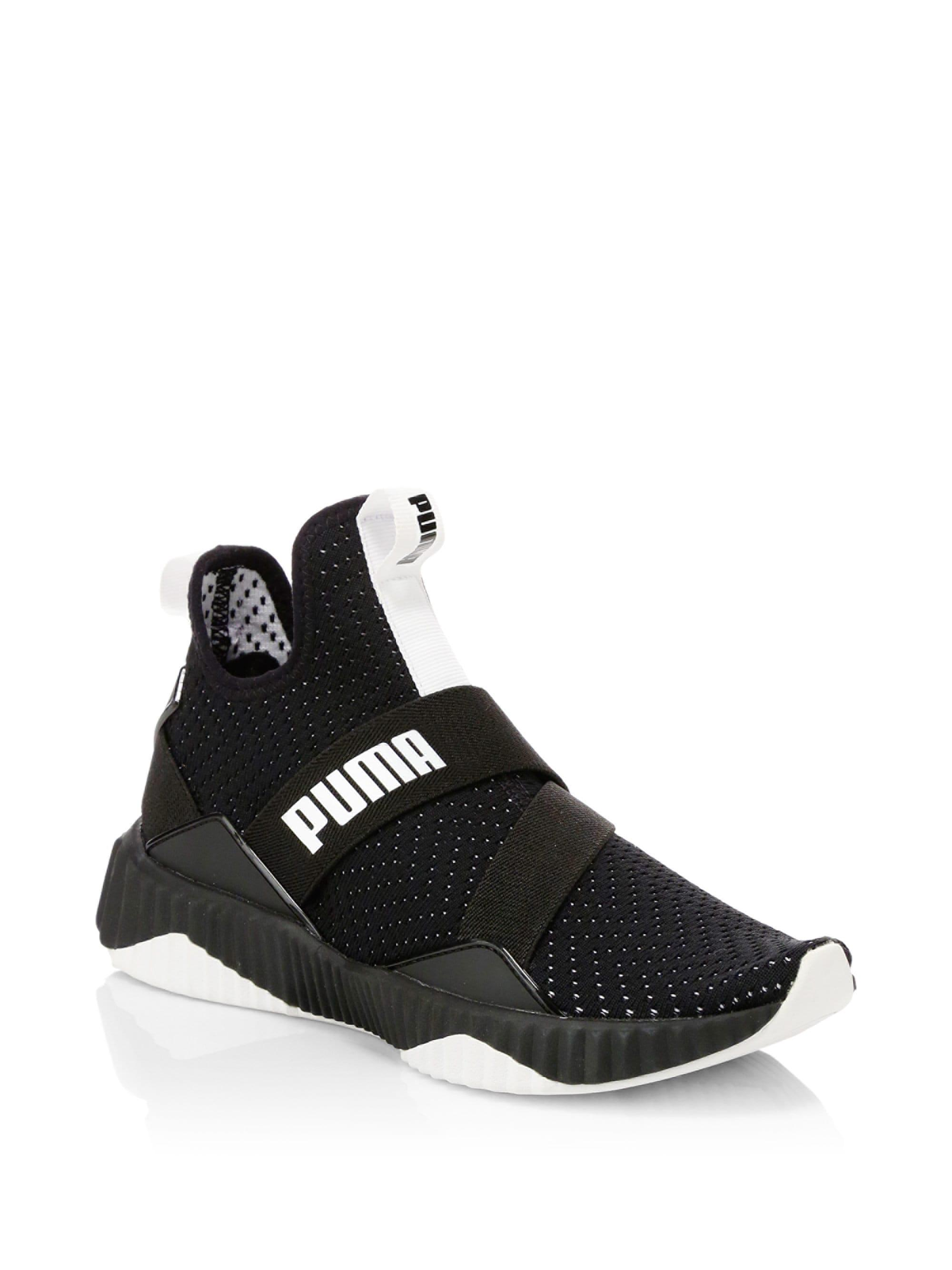 82fca76f5cf671 Lyst - PUMA Defy Wn s Knit Perforated Slip-on Runners in Black for Men