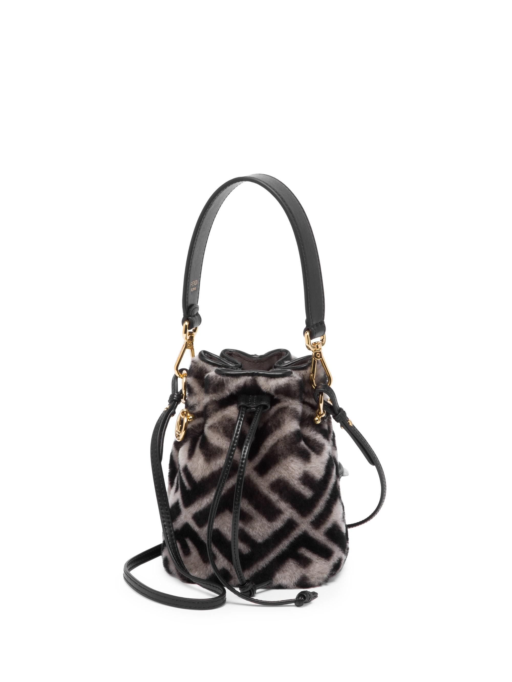 5ef38aec0f95 ... sweden fendi mini mon tresor shearling bucket bag in black lyst e6c71  88e67 ...