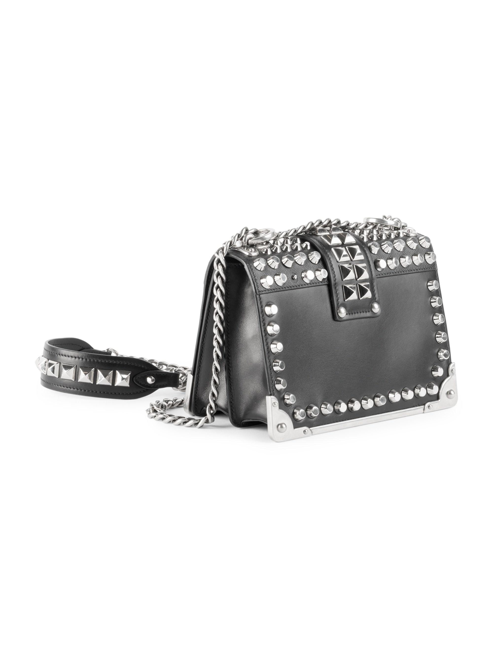 3a5ca295457a Prada - Women s Small Studded Cahier Leather Crossbody Bag - Black - Lyst.  View fullscreen