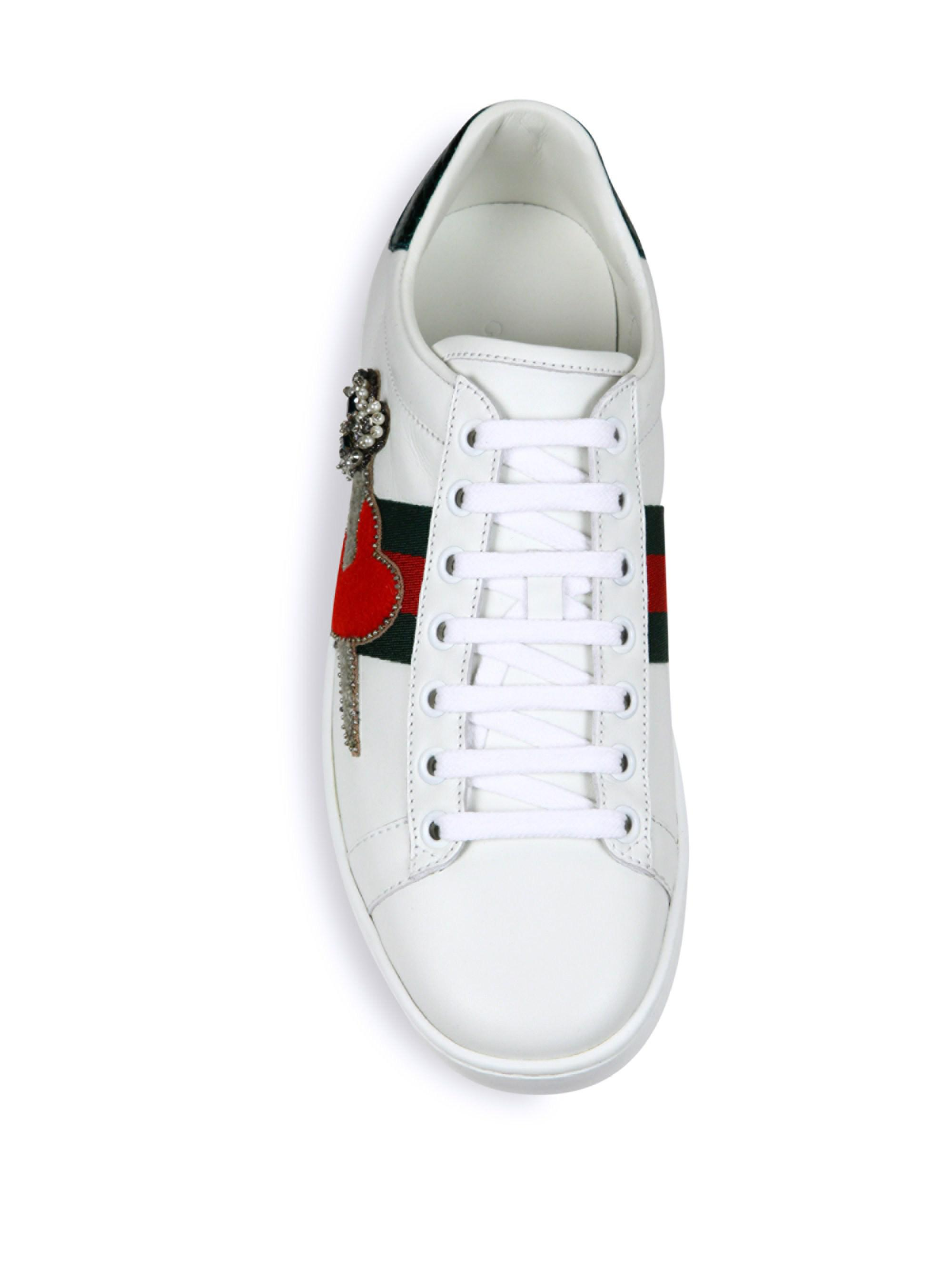 f79d8c7aae5 Gucci - White New Ace Pierced Heart Leather Sneakers - Lyst. View fullscreen