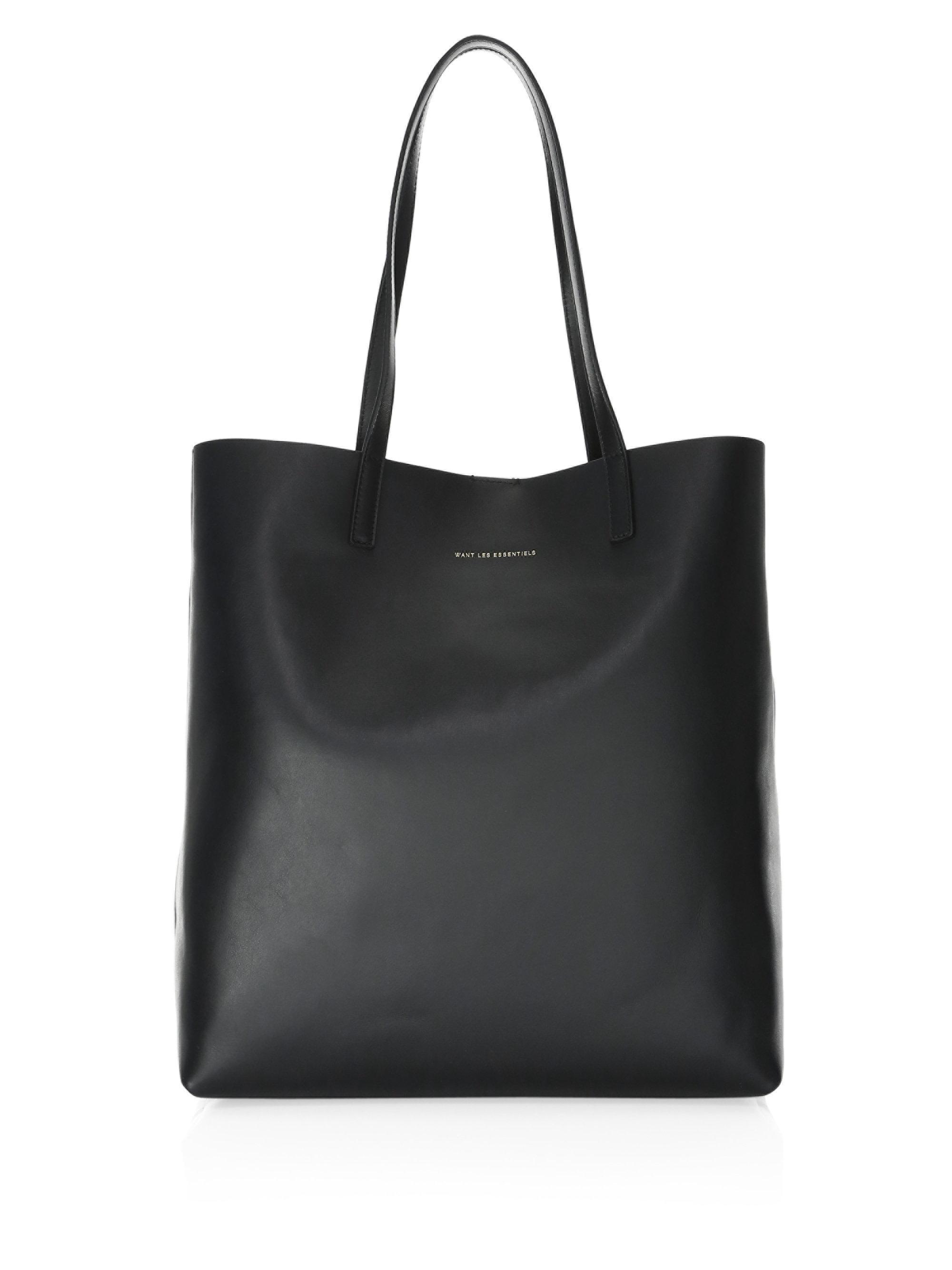 9b82fdff4 Want Les Essentiels De La Vie Logan Vertical Reversible Leather Tote ...