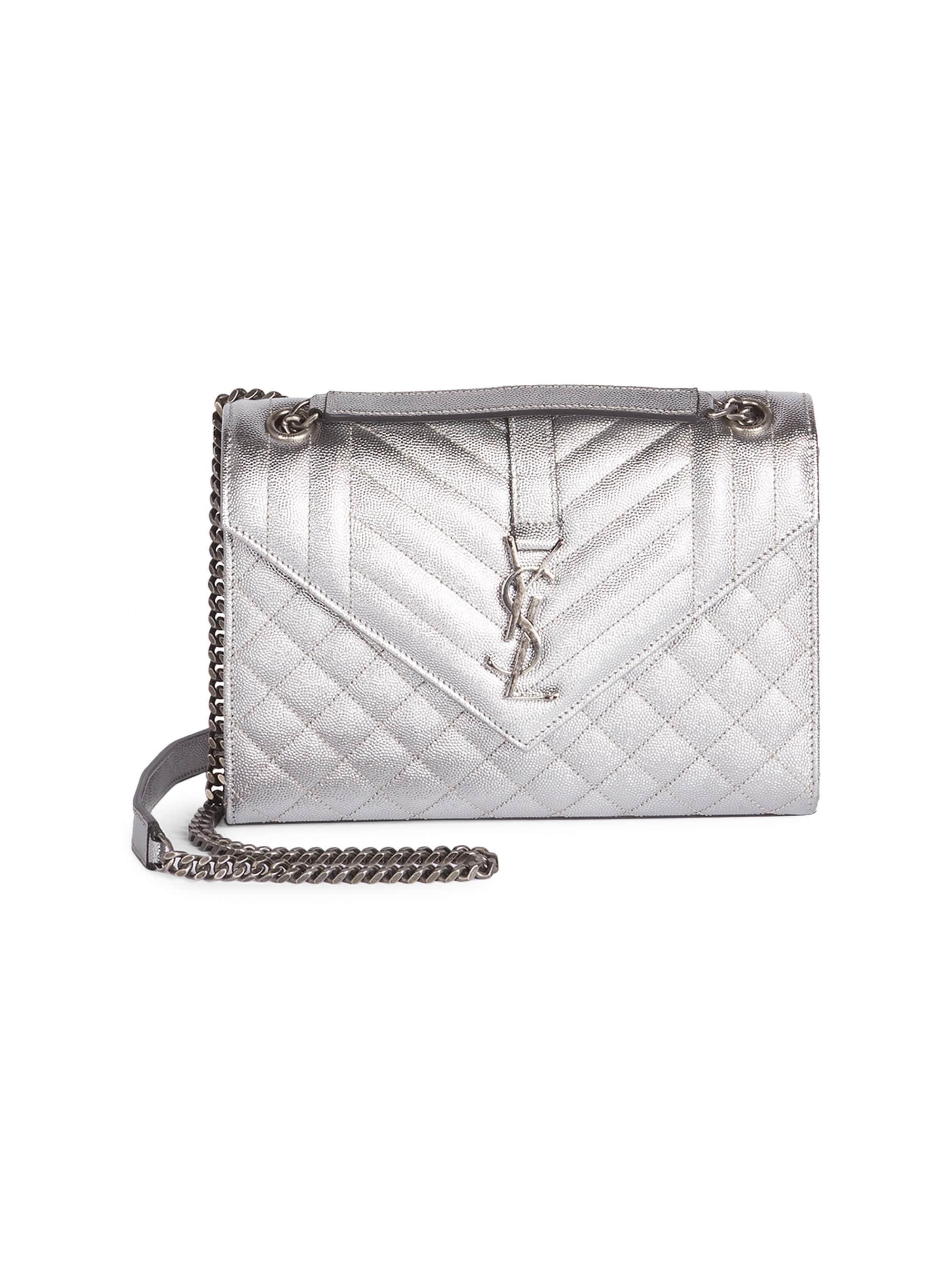 92940c8870 Saint Laurent. Metallic Women s Medium Embossed Leather Envelope Bag ...